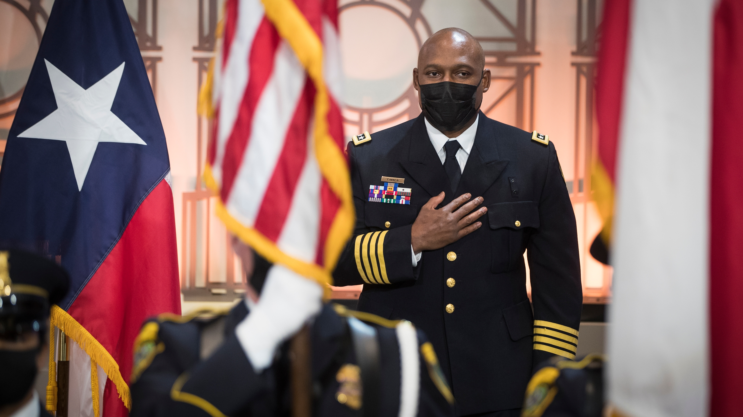 In this April 5, 2021, file photo, Houston Police Chief New Houston Police Chief Troy Finner stands for the national anthem before being sworn in as HPD's newest leader at City Hall in Houston. (Brett Coomer/Houston Chronicle via AP)