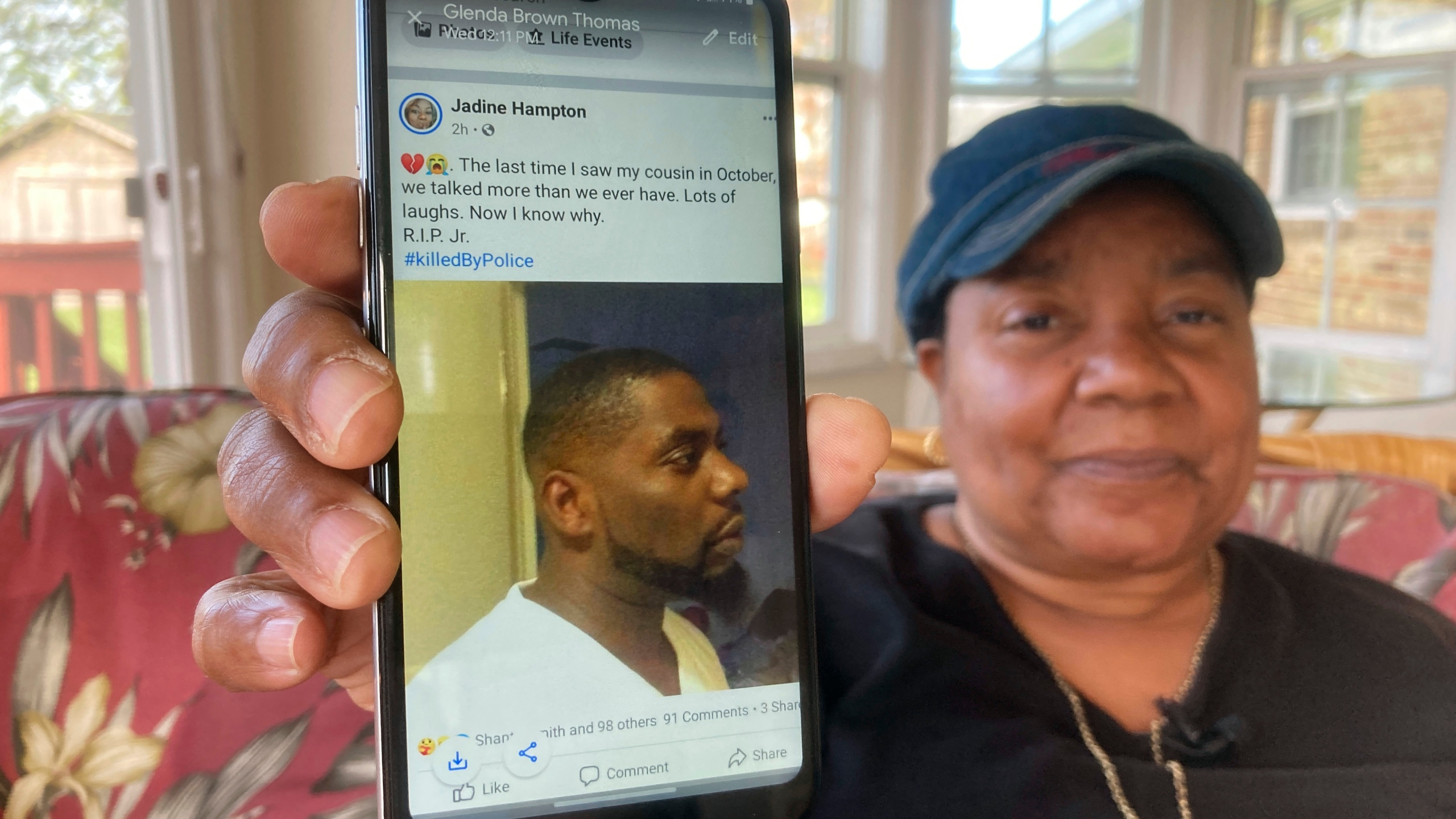 Glenda Brown Thomas displays a photo of her nephew, Andrew Brown Jr., on her cell phone at her home in Elizabeth City, N.C., on April 22, 2021. Brown was shot and killed by a sheriff's deputy who was attempting to execute a warrant. (Allen G. Breed / Associated Press)