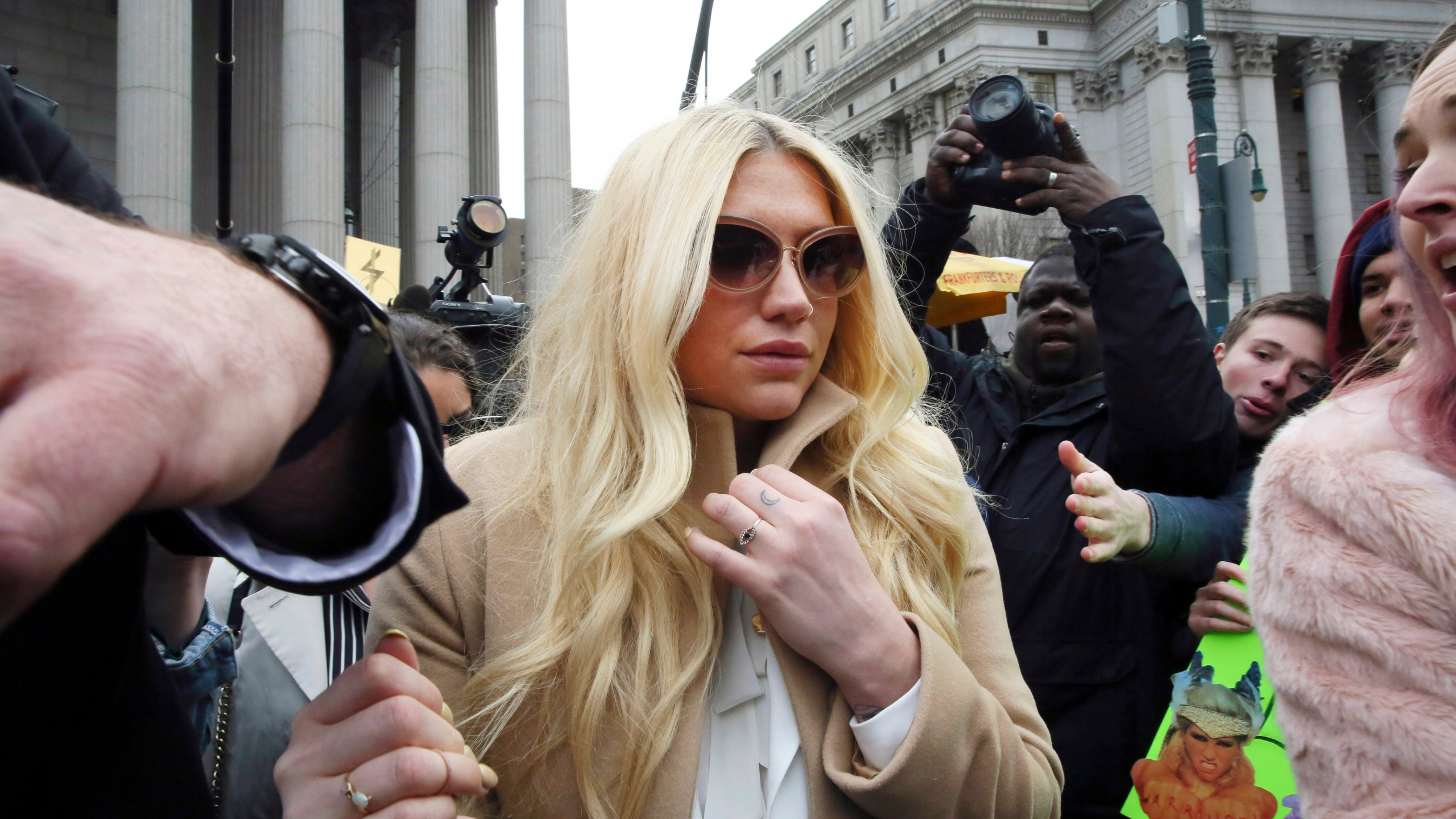 In this Feb. 19, 2016, file photo, pop star Kesha leaves Supreme court in New York after a hearing involving her producer, Dr. Luke. (AP Photo/Mary Altaffer, File)