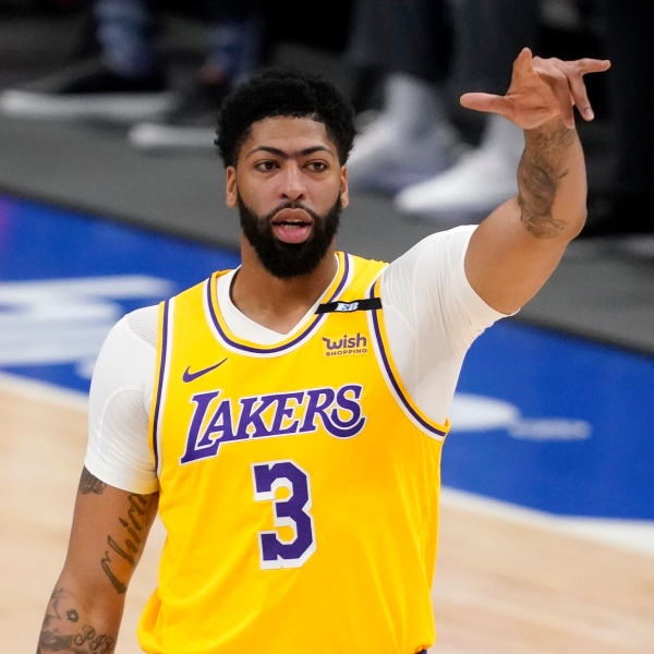 Los Angeles Lakers forward Anthony Davis gestures during the first half of the team's NBA basketball game against the Dallas Mavericks in Dallas, on April 22, 2021. (AP Photo/Tony Gutierrez)