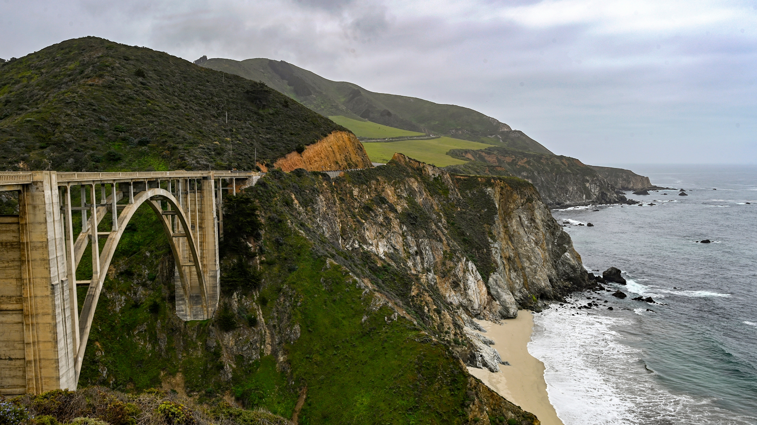 Bixby Bridge on Highway 1 near Big Sur, Calif., is seen on April 23, 2021. A section of California's scenic Highway 1 that collapsed during a winter storm in January 2021 has reopened to traffic. (AP Photo/Nic Coury)