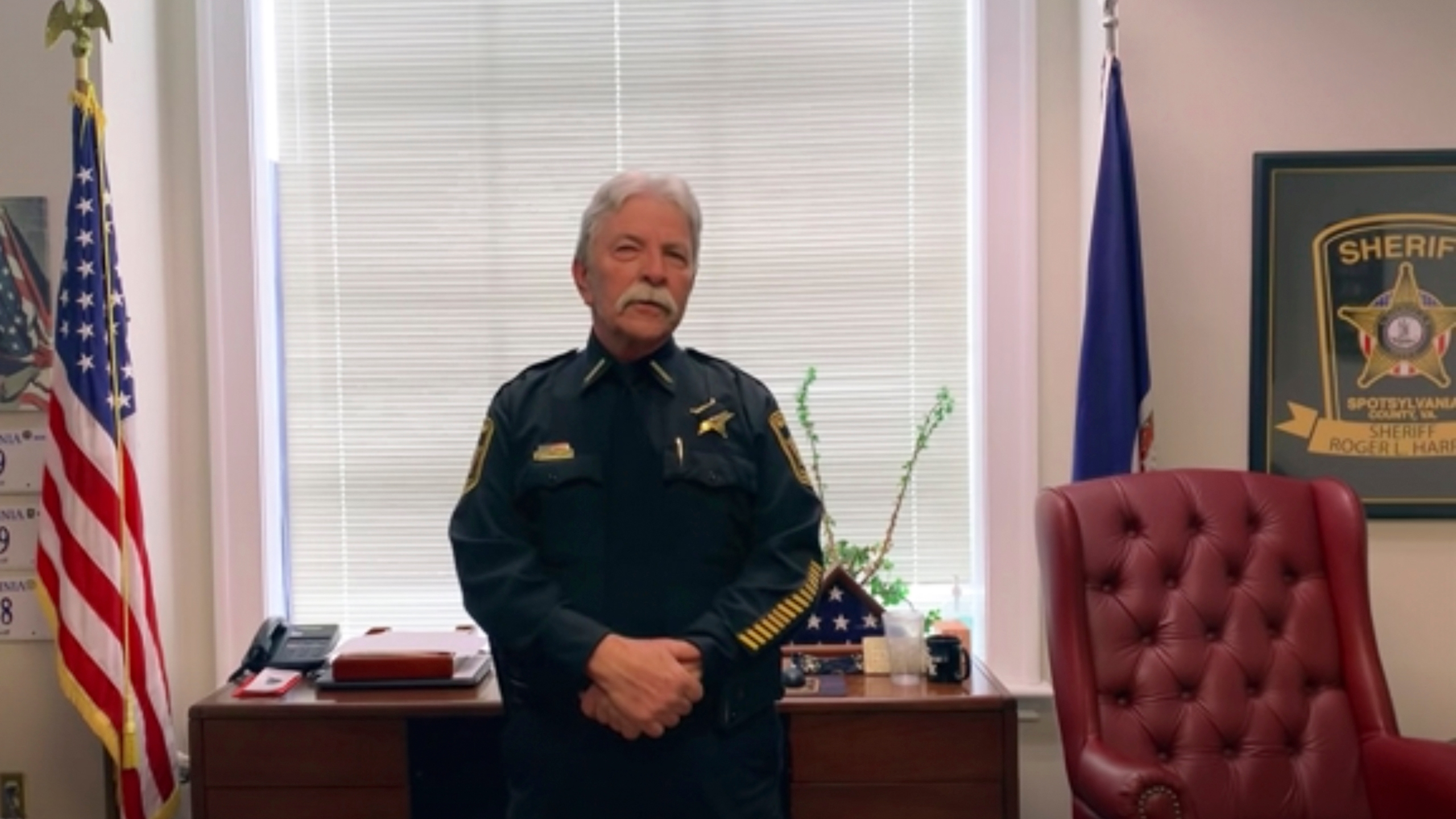 This photo provided by Spotsylvania County Sheriff's Office shows Spotsylvania County Sheriff Roger Harris explaining the Body camera footage and 911 audio released late Friday, April 23, 2021, that appeared to show that a Virginia deputy mistook a cordless house phone held by a Black man for a gun before the deputy shot him repeatedly. Family members said Isaiah Brown, 32, was in intensive care with 10 bullet wounds following the shooting outside a home in Spotsylvania County, Va., early Wednesday, (Spotsylvania County Sheriff's Office via AP)