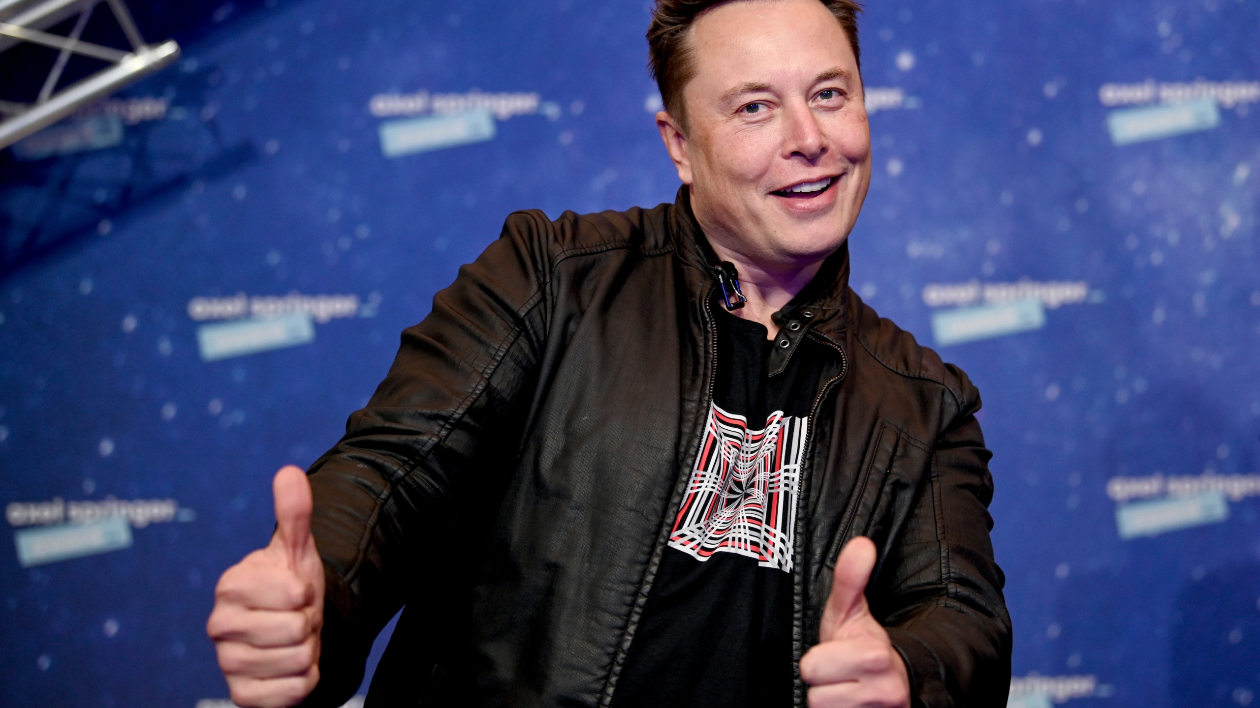 """In this Tuesday, Dec. 1, 2020 file photo, SpaceX owner and Tesla CEO Elon Musk arrives on the red carpet for the Axel Springer media award, in Berlin, Germany. Technology mogul Elon Musk has a lined up a new gig in addition to his jobs as CEO of electric car maker Tesla and spaceship maker SpaceX. He is going to host the iconic TV show """"Saturday Night Live """" on May 8, 2021. (AP Photo/Britta Pedersen, Pool, File)"""