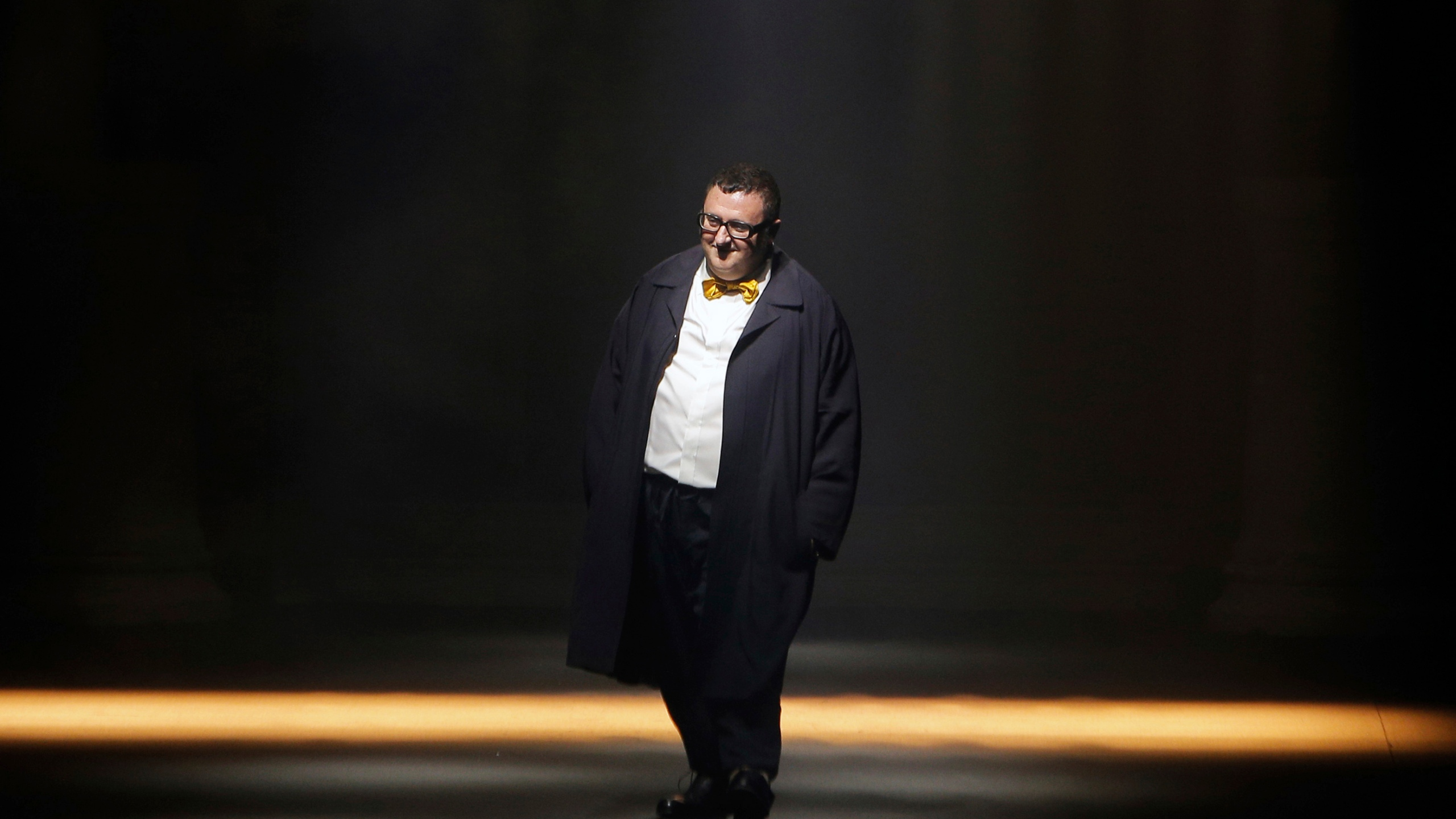 In this file photo dated Thursday, Oct. 1, 2015, Israeli fashion designer Alber Elbaz acknowledges applause at the end of his Spring-Summer 2016 ready-to-wear fashion collection for Lanvin, presented during the Paris Fashion Week, in Paris. (AP Photo/Thibault Camus, File)