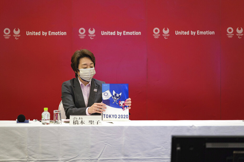Seiko Hashimoto, the head of the Tokyo Olympics (Tokyo 2020) organizing committee, holds a Tokyo 2020 folder during a Tokyo 2020 executive board meeting Monday, April 26, 2021 in Tokyo, Japan. (Nicolas Datiche/Pool Photo via AP)