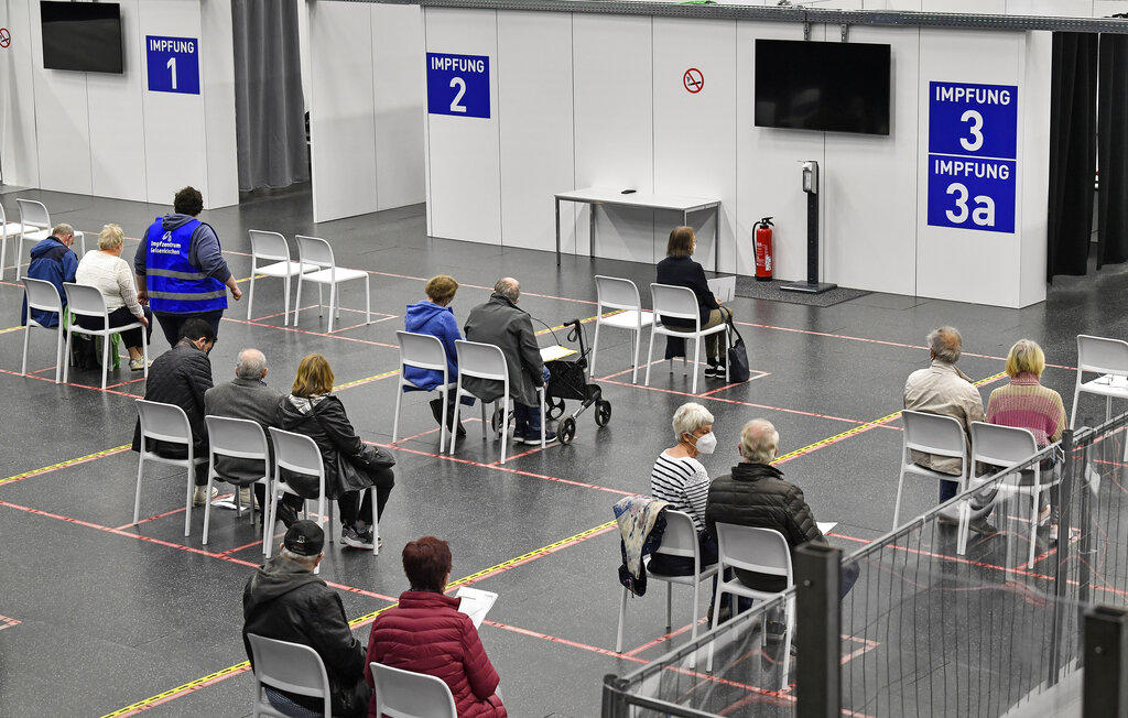 People wait at the vaccination center in Gelsenkirchen, Germany, Monday, April 26, 2021. (AP Photo/Martin Meissner)