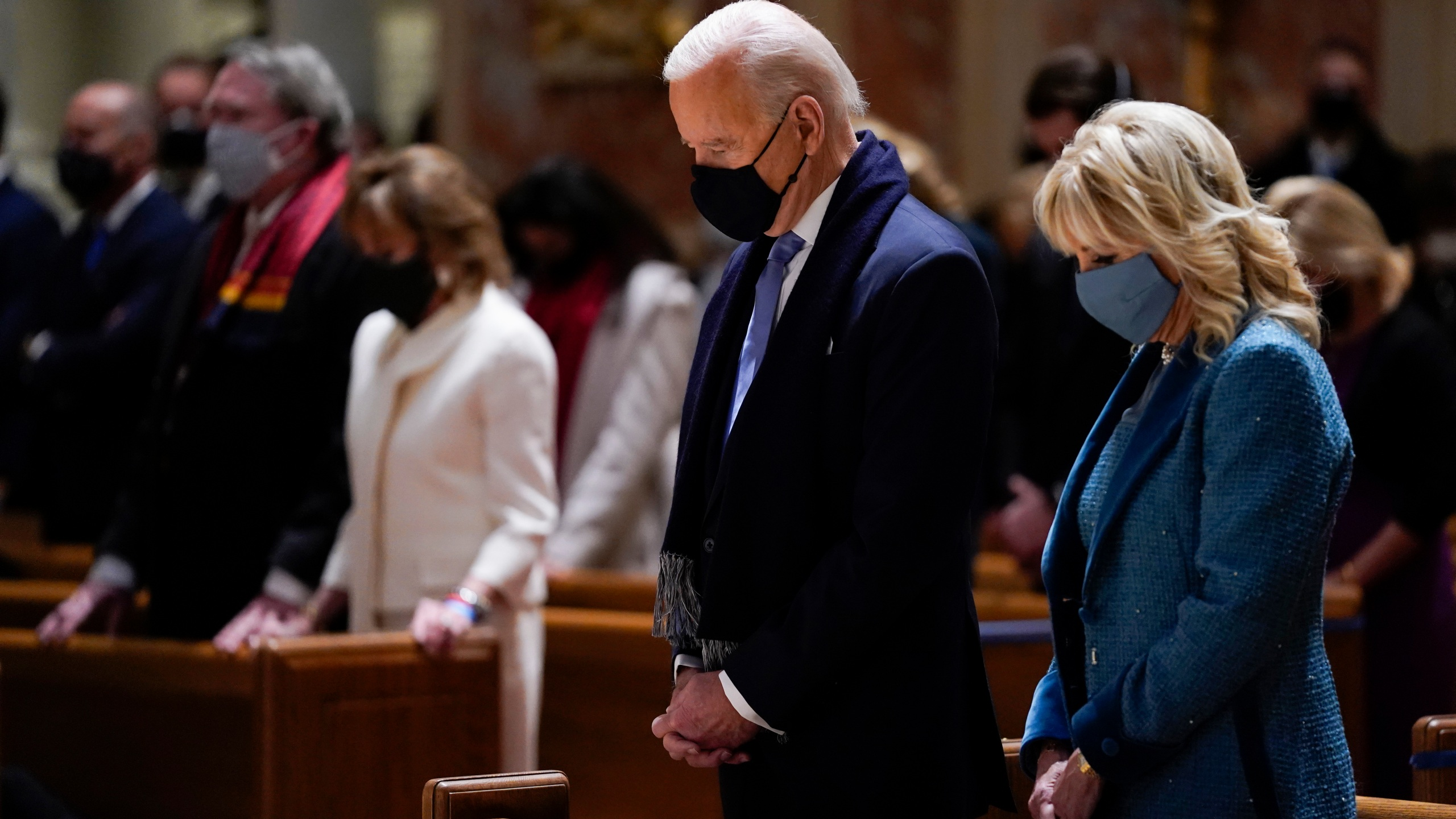 In this Wednesday, Jan. 20, 2021 file photo, President-elect Joe Biden and his wife, Jill Biden, attend Mass at the Cathedral of St. Matthew the Apostle during Inauguration Day ceremonies in Washington. When U.S. Catholic bishops hold their next national meeting in June 2021, they'll be deciding whether to send a tougher-than-ever message to President Joe Biden and other Catholic politicians: Don't partake of Communion if you persist in public advocacy of abortion rights.(AP Photo/Evan Vucci)