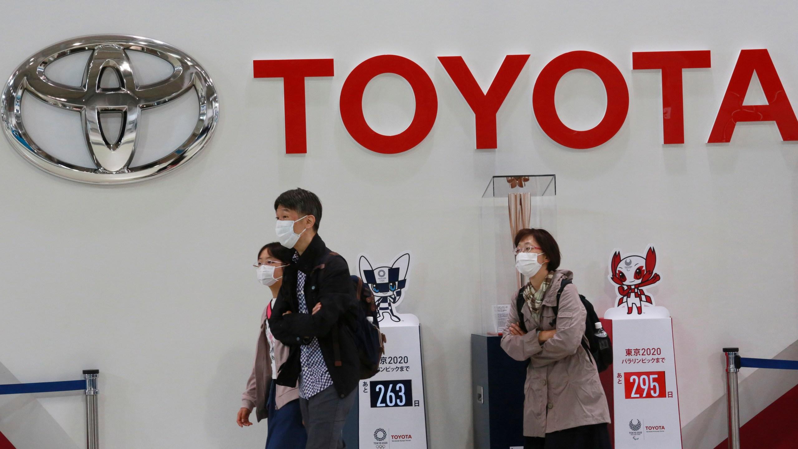 In this Nov. 2, 2020, file photo, visitors walk at a Toyota showroom in Tokyo. (AP Photo/Koji Sasahara, File)
