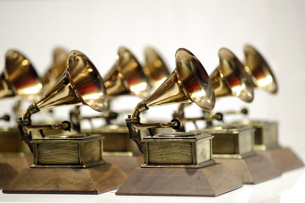 In this Oct. 10, 2017, file photo, various Grammy Awards are displayed at the Grammy Museum Experience at Prudential Center in Newark, N.J. (AP Photo/Julio Cortez, File)