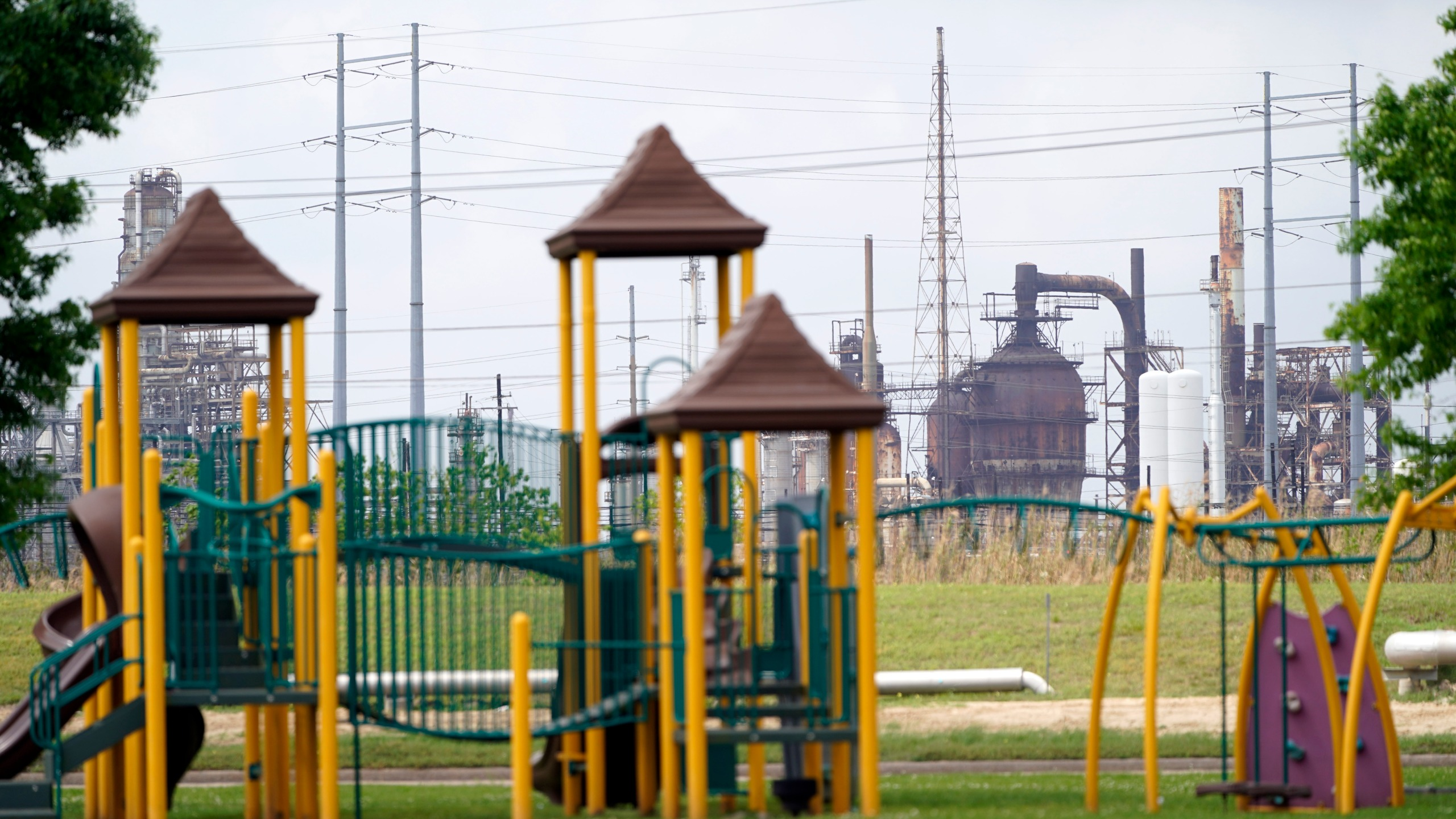 In this March 23, 2020 file photo, a playground outside the Prince Hall Village Apartments sits empty near one of the petrochemical facilities in Port Arthur, Texas. (David J. Phillip)