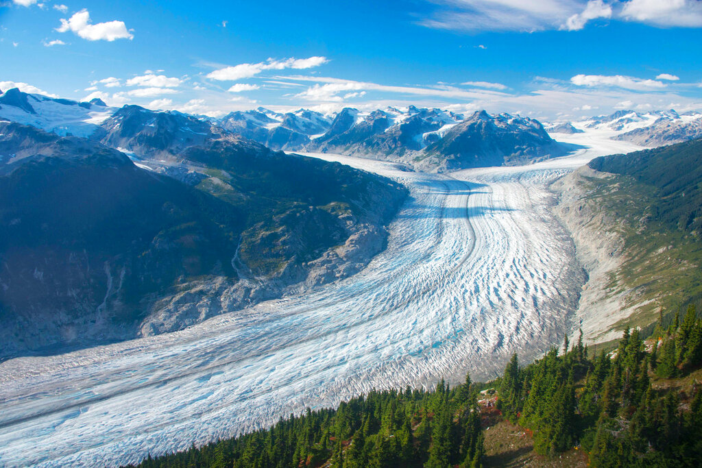 This September 2017 photo provided by researcher Brian Menounos shows the Klinaklini glacier in British Columbia, Canada. The glacier and the adjacent icefield lost about 15 gigatons of water from 2000-2019, Menounos says. (Brian Menounos via AP)
