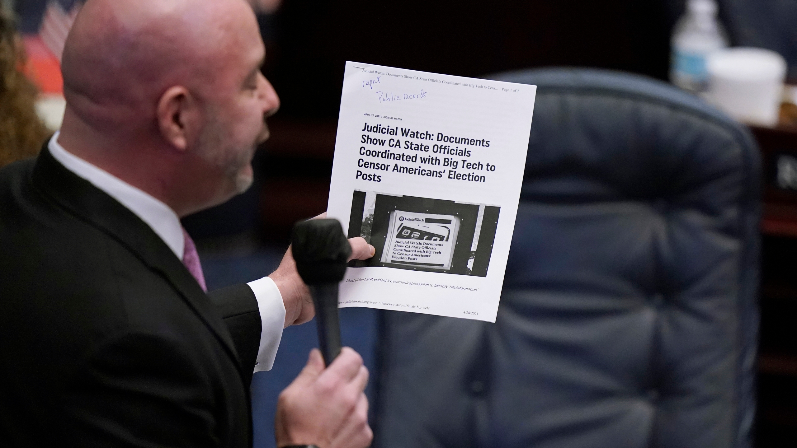 Florida Rep. Blaise Ingoglia holds up an article from Judicial Watch, as he speaks during a legislative session, Wednesday, April 28, 2021, at the Capitol in Tallahassee, Fla. (AP Photo/Wilfredo Lee)
