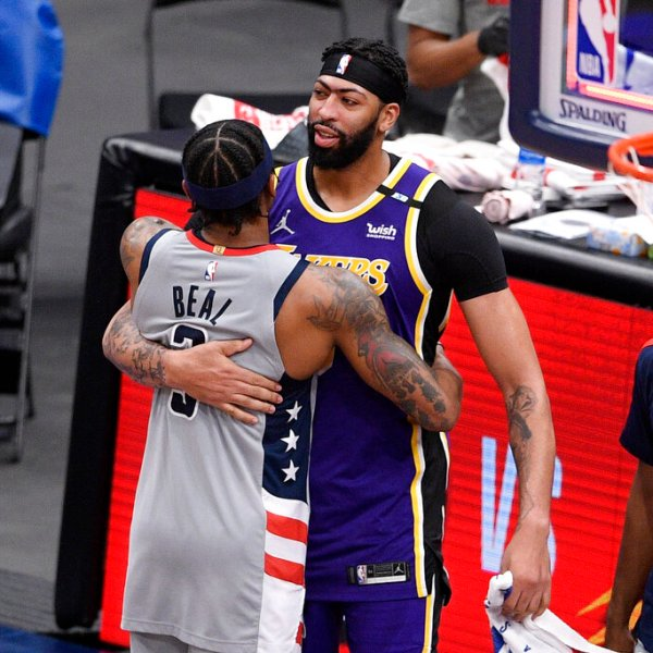 Washington Wizards guard Bradley Beal, left, and Los Angeles Lakers forward Anthony Davis, right, hug after an NBA basketball game, Wednesday, April 28, 2021, in Washington. The Wizards won 116-107. (AP Photo/Nick Wass)