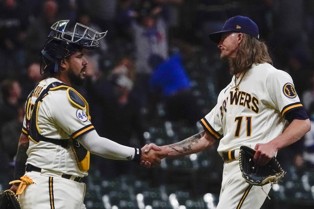 Milwaukee Brewers' Josh Hader is congratulated by catcher Omar Narvaez after picking up a save after a baseball game against the Los Angeles Dodgers Thursday, April 29, 2021, in Milwaukee. The Brewers won 2-1. (AP Photo/Morry Gash)
