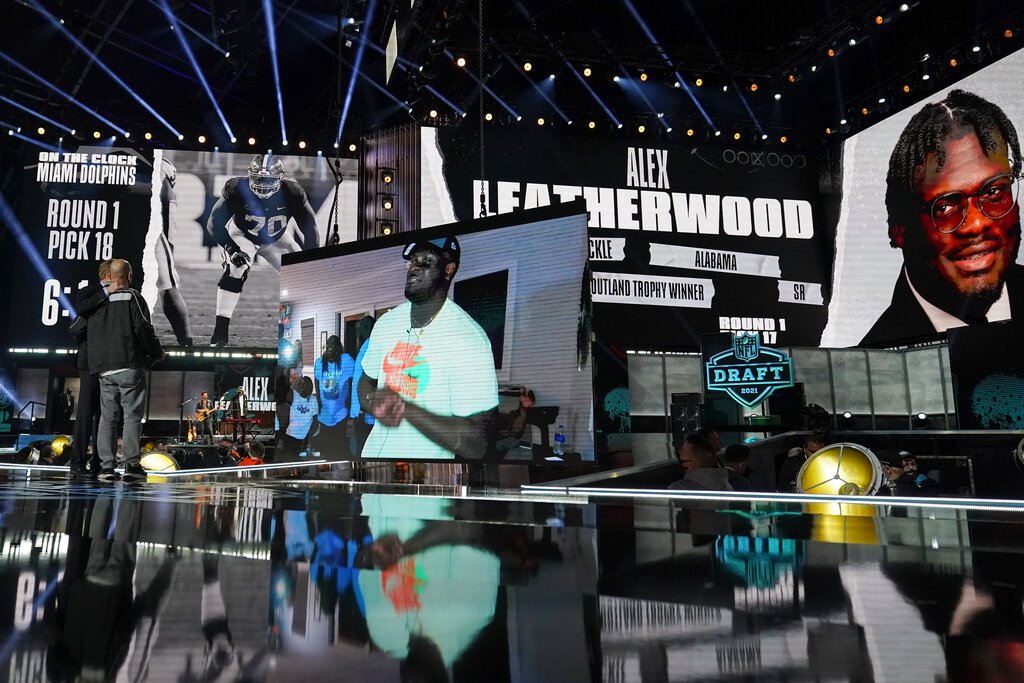 An image of Alabama tackle Alex Leatherwood is displayed on stage after he was chosen by the Las Vegas Raiders with the 17th pick during the first round of the NFL football draft, Thursday, April 29, 2021, in Cleveland. (AP Photo/Tony Dejak)