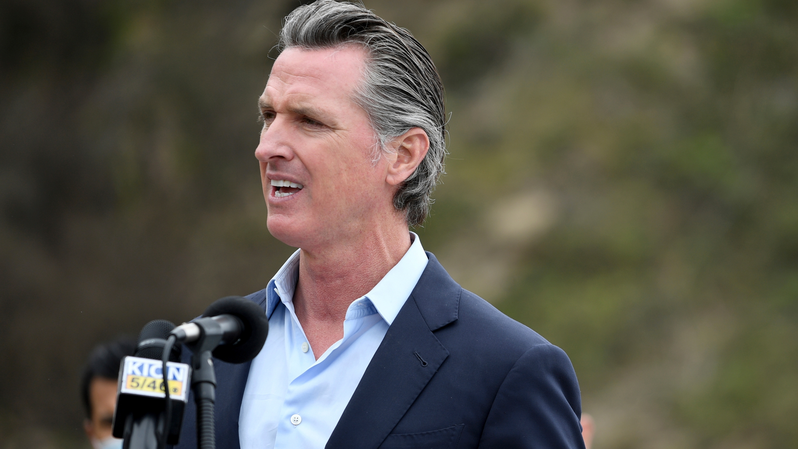 In this April 23, 2021, file photo, California Gov. Gavin Newsom speaks during a press conference in Big Sur, Calif. California on Saturday is increasing early release credits for tens of thousands of inmates including violent and repeat felons as it further trims the population of what once was the nation's largest state correctional system. Officials announced in mid-April that they will close a second prison as a result of the dwindling population, fulfilling a promise by Newsom. (AP Photo/Nic Coury, File)