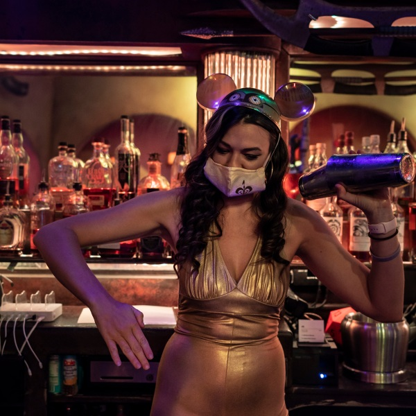 Dressed in a Star Wars theme to celebrate Star Wars Day, bartender Karissa Marston jokingly strikes a pose while making a cocktail for a customer at Scum and Villainy Cantina, a geek bar on Hollywood Boulevard in Los Angeles, on May 4, 2021. (Jae C. Hong / Associated Press)