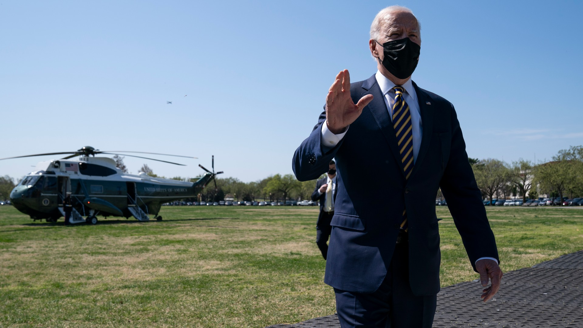 President Joe Biden talks with reporters on the Ellipse on the National Mall after spending the weekend at Camp David, Monday, April 5, 2021, in Washington. (AP Photo/Evan Vucci)