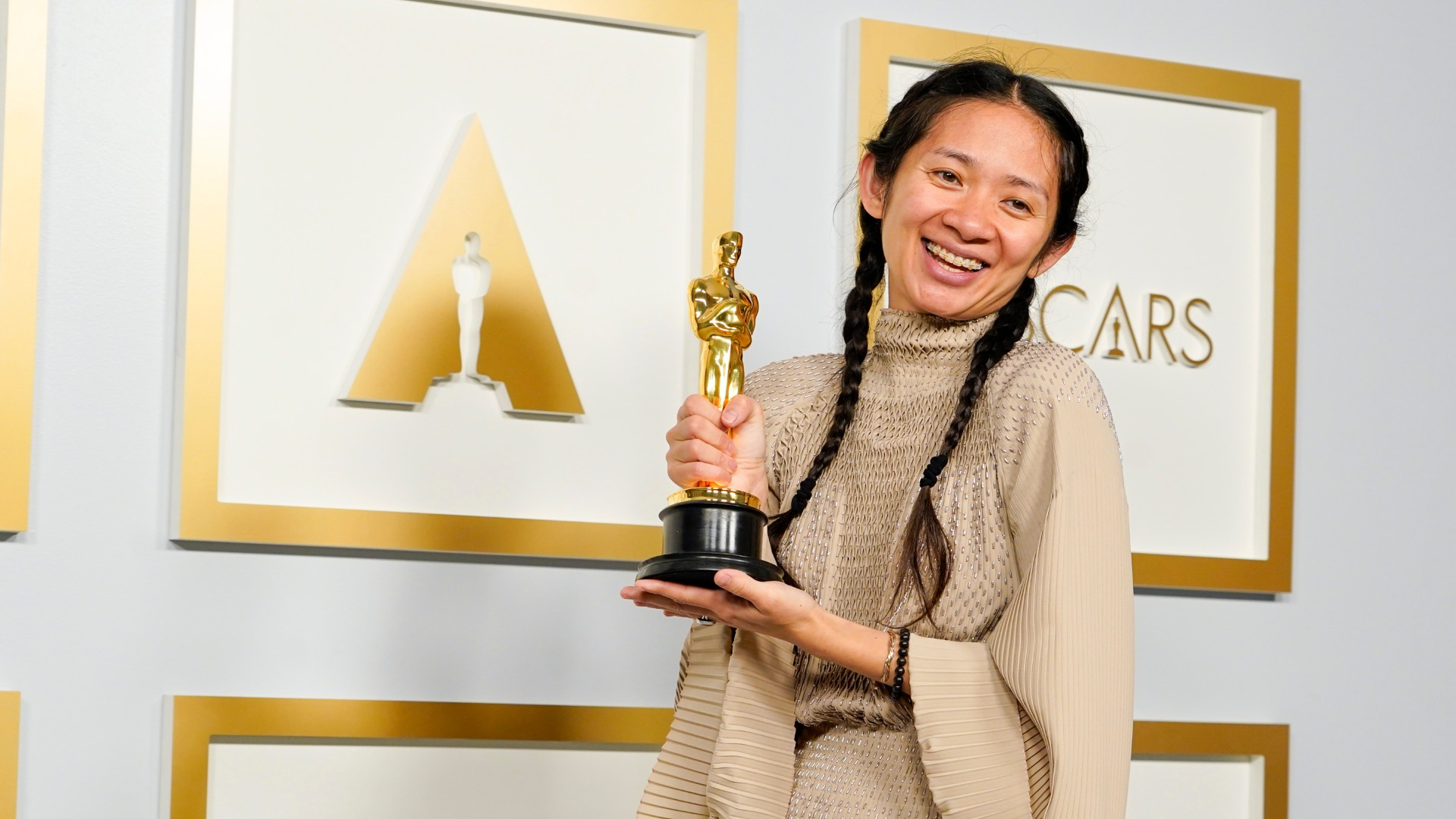 """Director/Producer Chloe Zhao, winner of Best Picture for """"Nomadland,"""" poses in the press room at the Oscars on Sunday, April 25, 2021, at Union Station in Los Angeles. (Chris Pizzello-Pool/Getty Images)"""