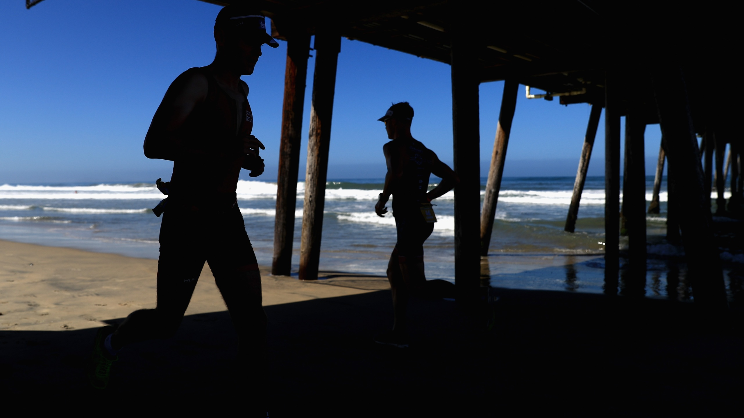 Competitors run under the Imperial Beach pier during the run portion of the IRONMAN 70.3 Superfrog on Sept. 16, 2018 in Imperial Beach, California. (Sean M. Haffey/Getty Images for IRONMAN)