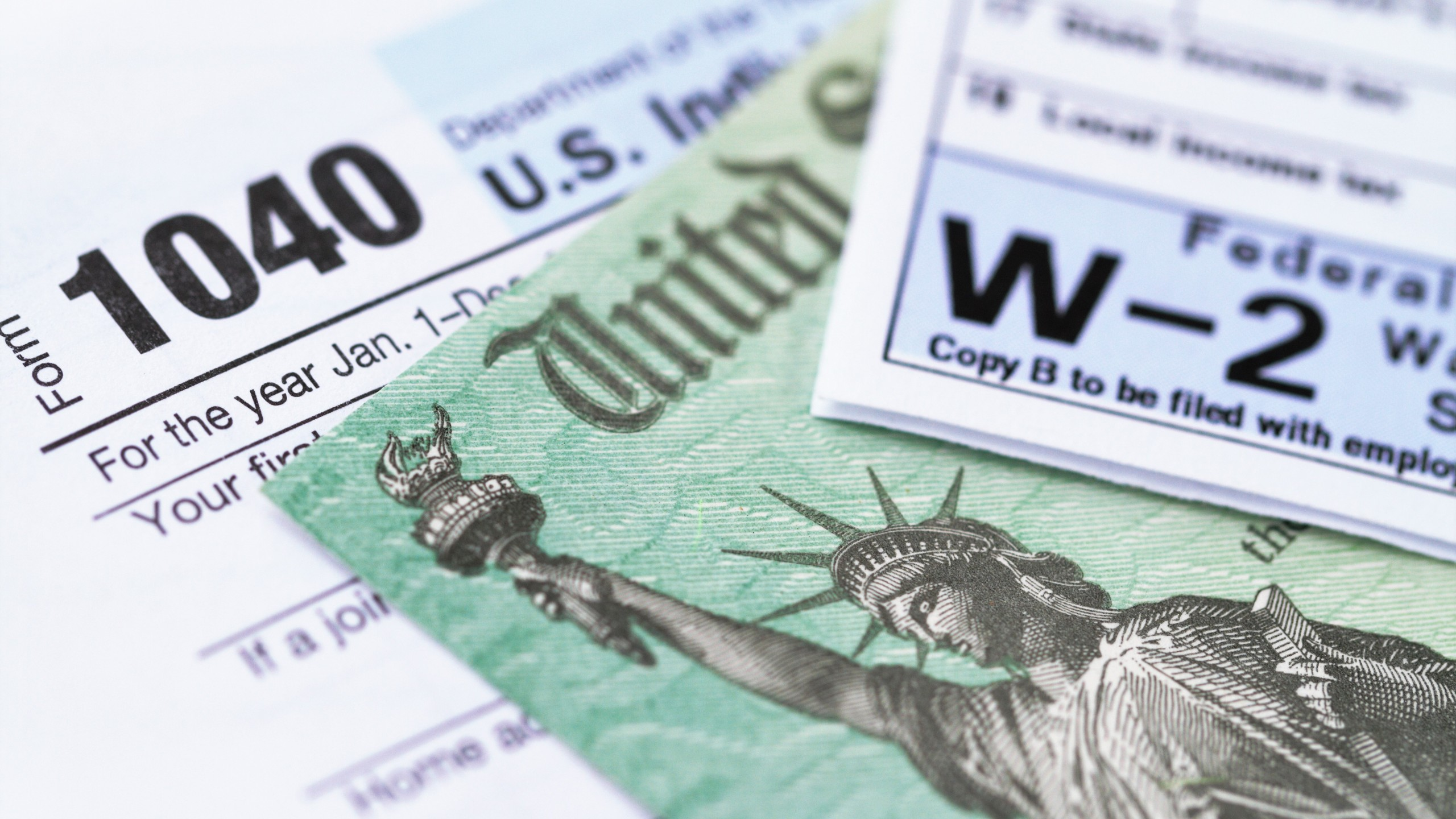 An IRS tax form with a tax refund check are seen in a file photo. (iStock/Getty Images Plus)