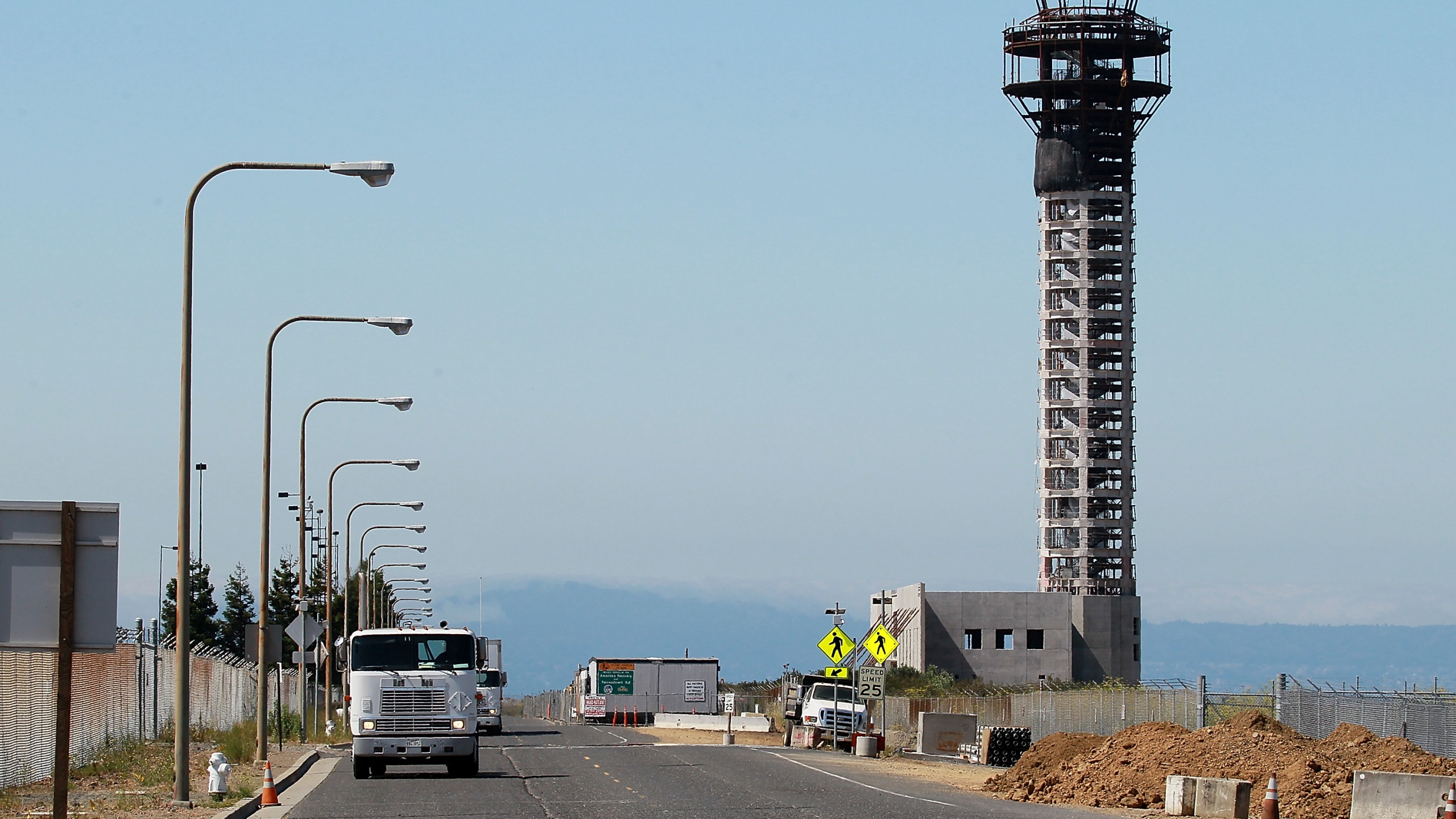Trucks drive down a road near a half-completed 236-foot FAA control tower at Oakland International Airport on August 3, 2011 in Oakland. (Justin Sullivan/Getty Images)