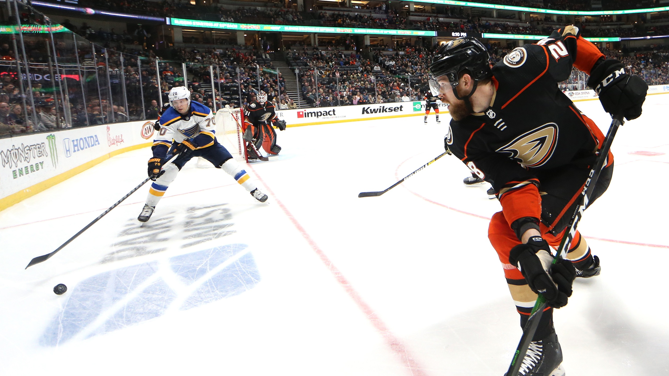 Oskar Sundqvist #70 of the St. Louis Blues controls the puck as Jani Hakanpaa #28 of the Anaheim Ducks defends during the second period of a game at Honda Center on March 11, 2020 in Anaheim. (Sean M. Haffey/Getty Images)