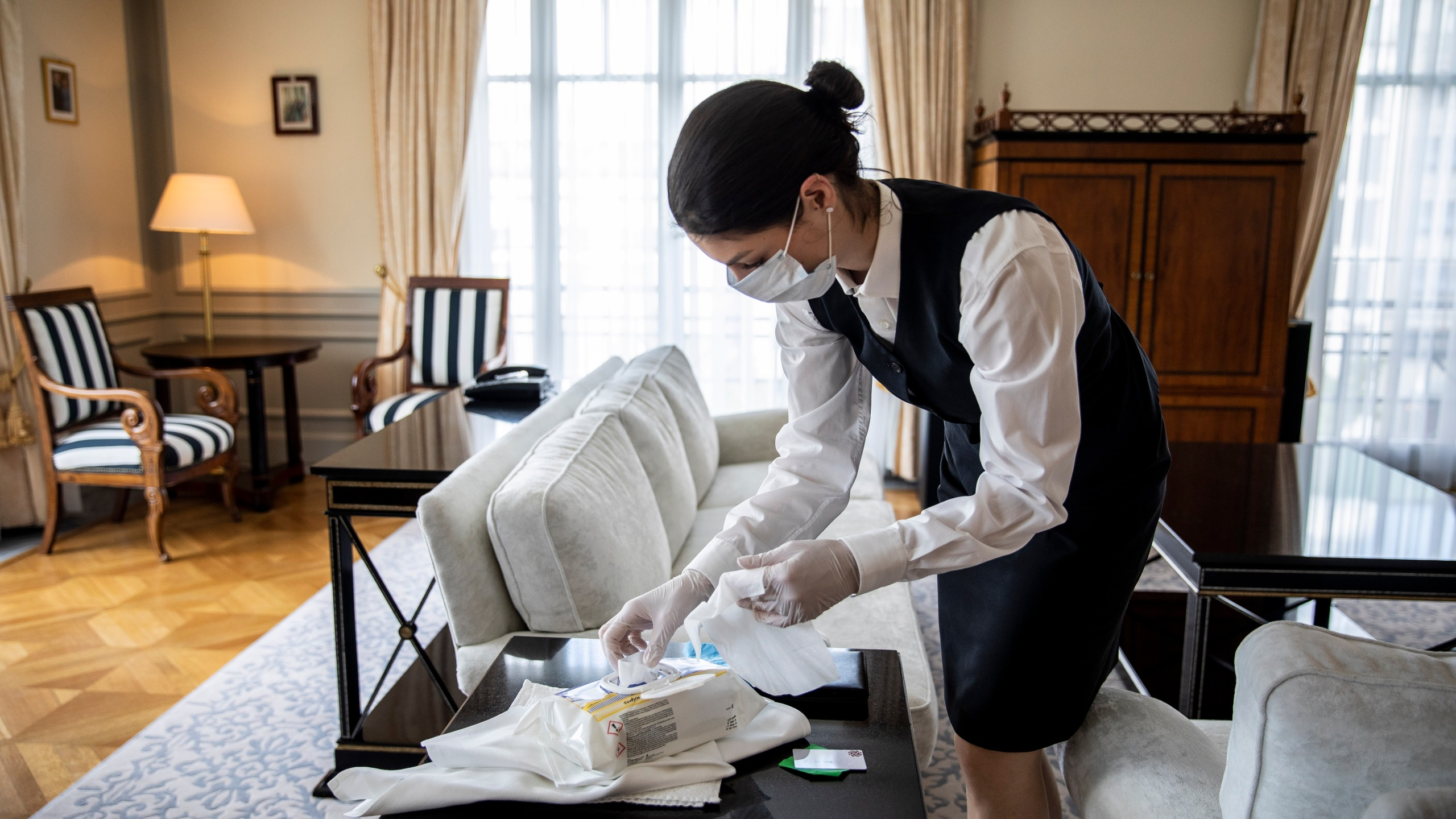 This file photo shows a housekeeper cleaning a hotel suite in Berlin, Germany on May 26, 2020. (Maja Hitij/Getty Images)