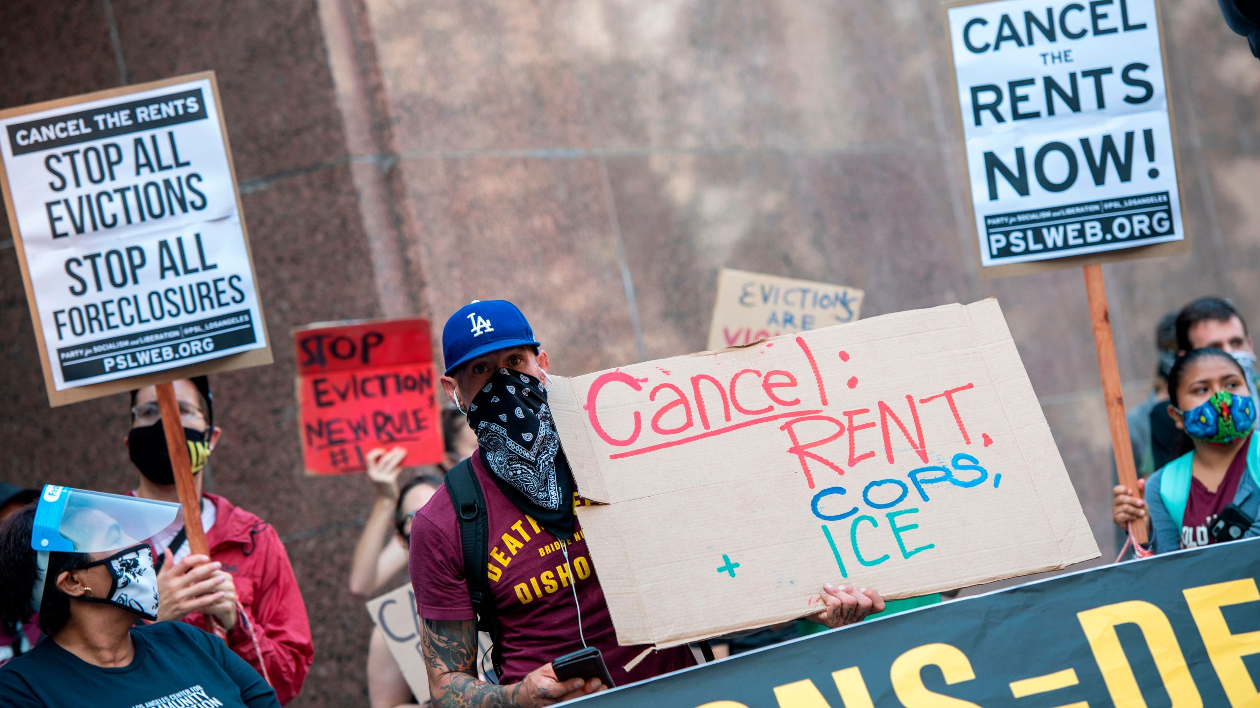 Renters and housing advocates attend a protest to cancel rent and avoid evictions in front of the court house amid Coronavirus pandemic on Aug. 21, 2020, in Los Angeles. (VALERIE MACON/AFP via Getty Images)