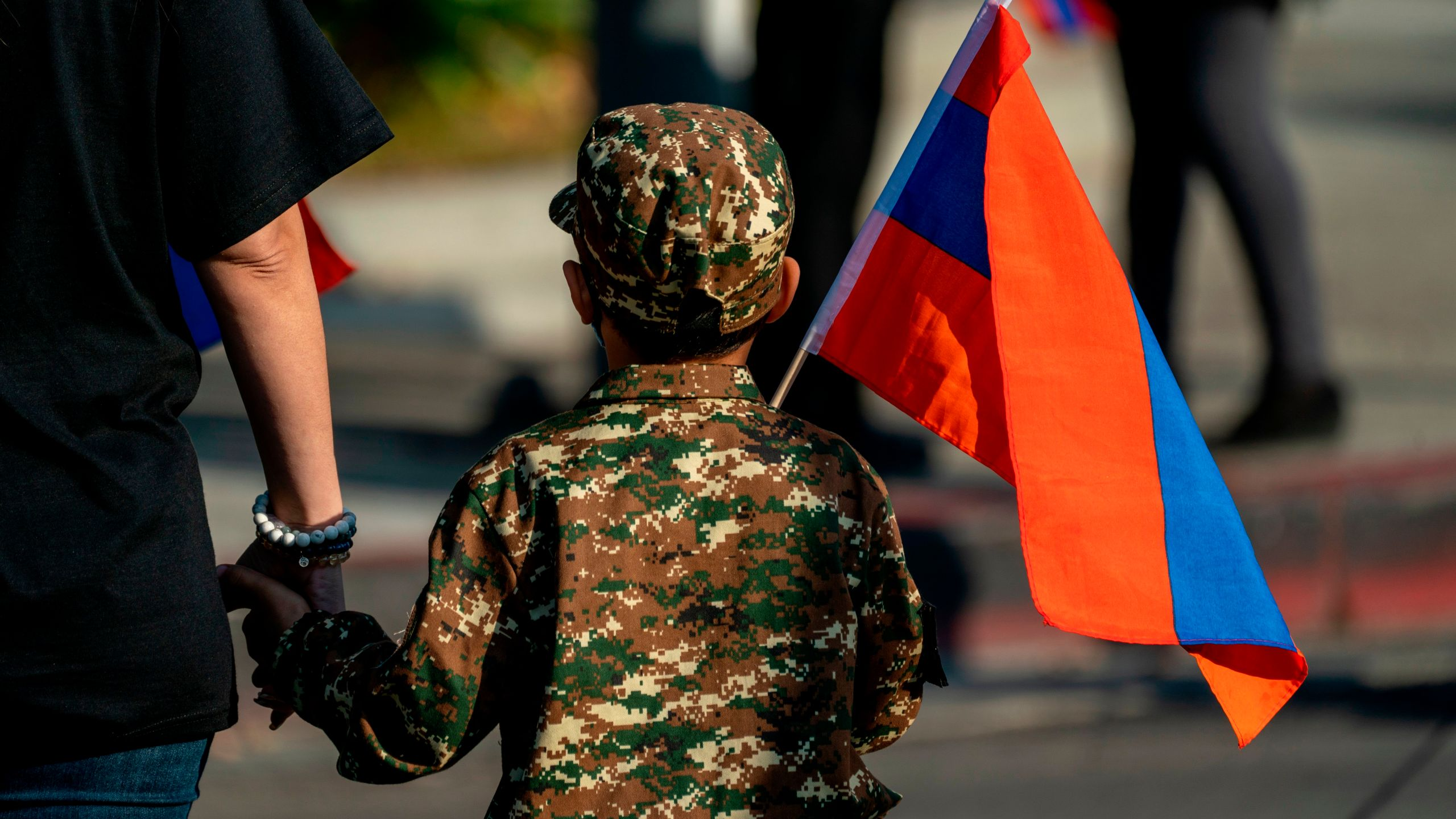 A boy holding an Armenian flag marches with others from Pan Pacific Park to the Consulate General of Turkey in Los Angeles, California, during a protest in support of Armenia and Karabakh amid the territorial dispute with Azerbaijan over Nagorno-Karabakh, on Oct. 11, 2020. (KYLE GRILLOT/AFP via Getty Images)