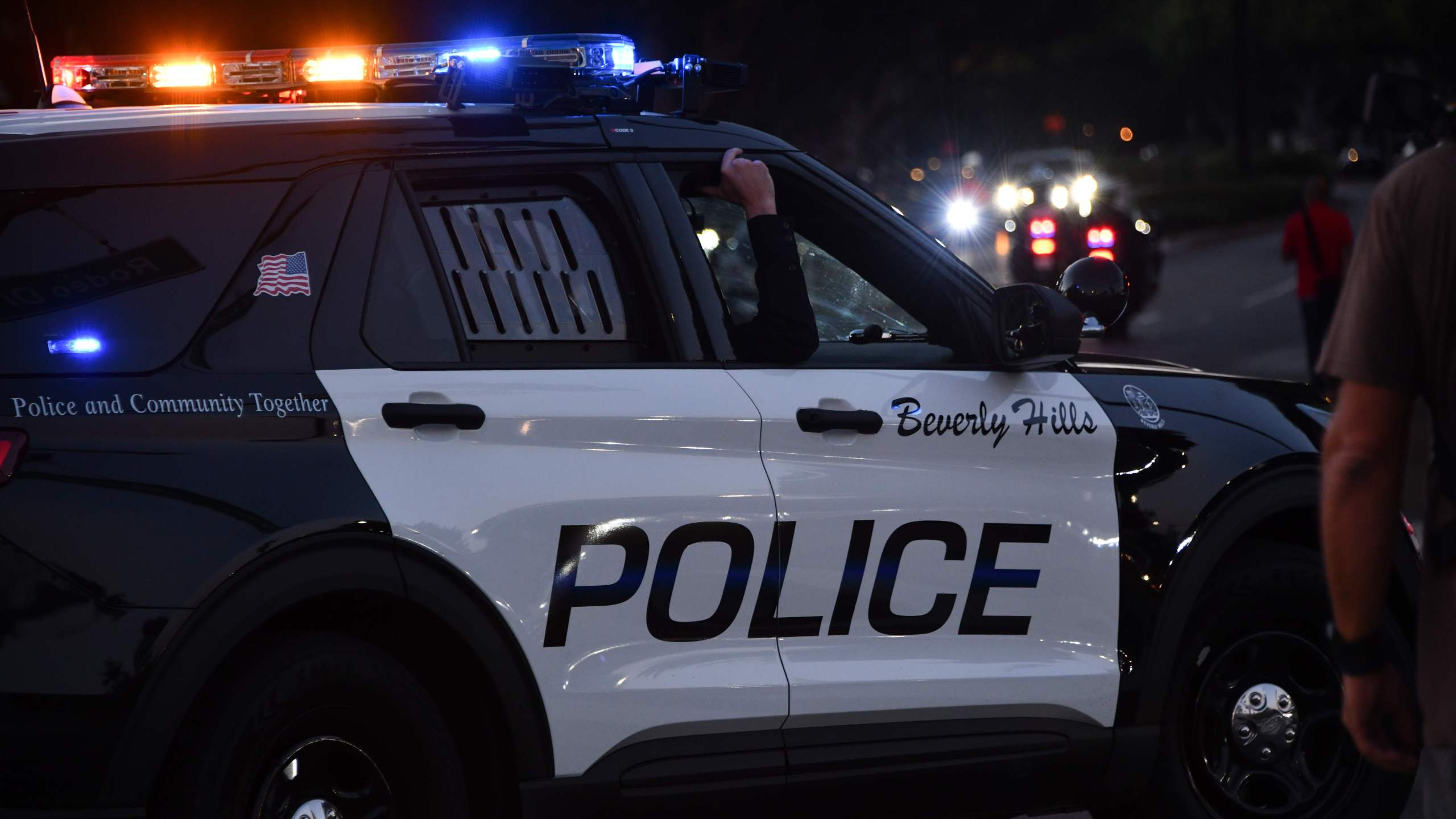Beverly Hills police officers patrol in their car on November 1, 2020 in Beverly Hills. (Photo by Chris Delmas/AFP via Getty Images)