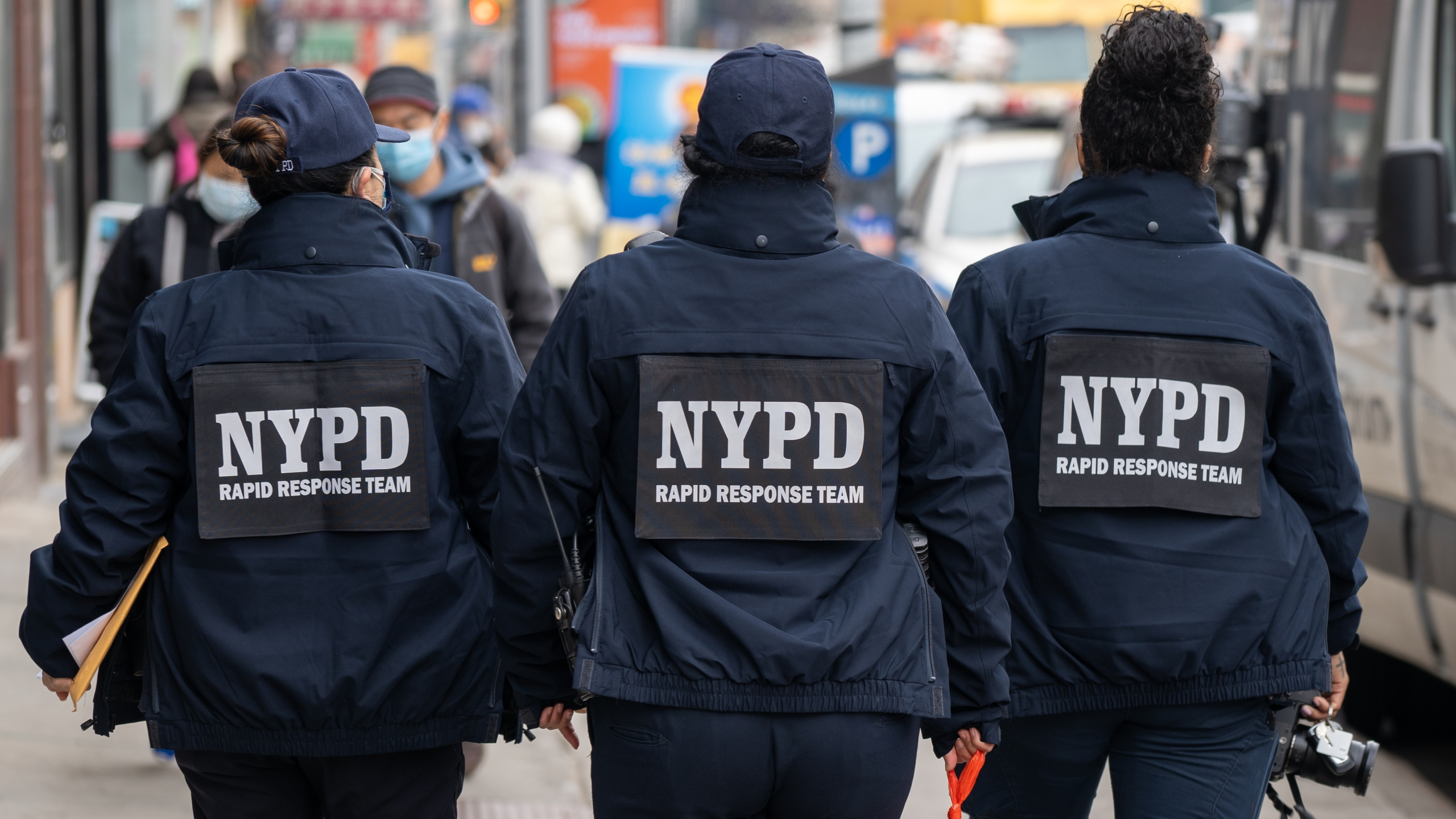 NYPD officers hand out information about hate crimes in Asian communities on March 17, 2021 in New York City. (David Dee Delgado/Getty Images)