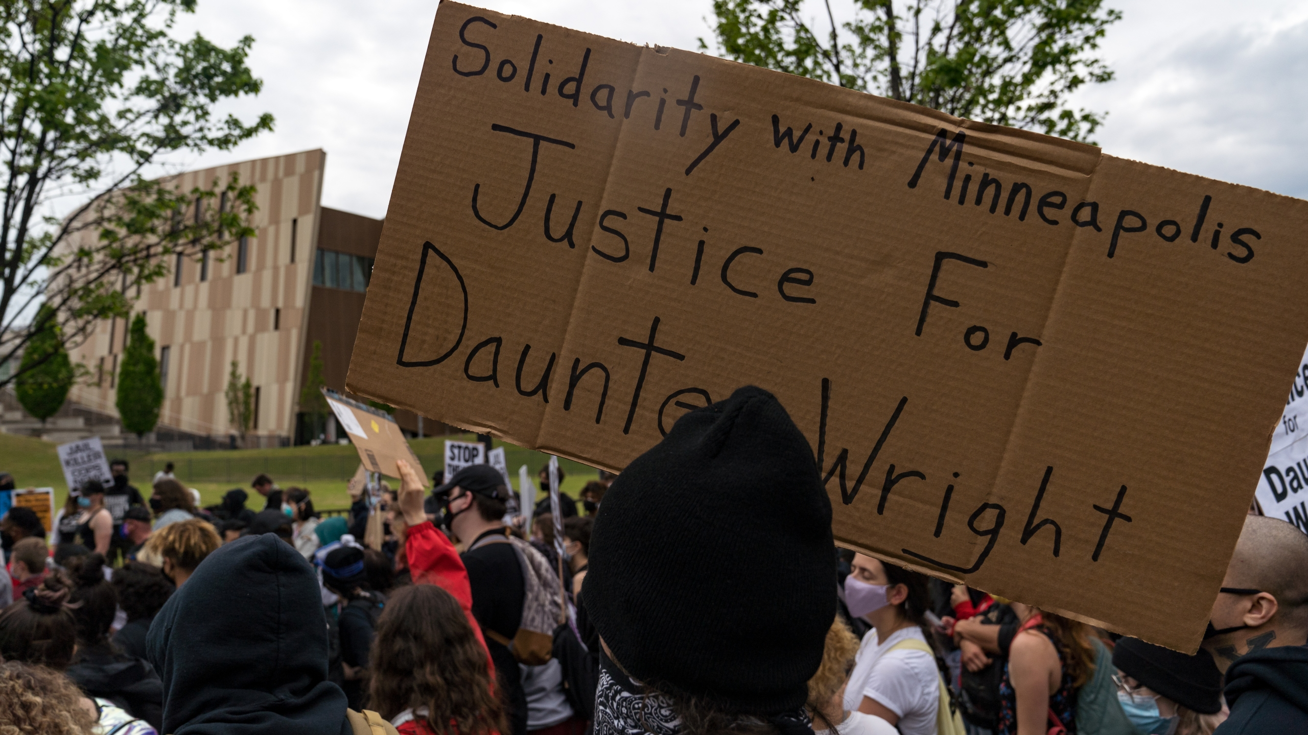 Demonstrators march to the National Center for Civil and Human Rights while protesting the shooting death of Daunte Wright on April 14, 2021, in Atlanta, Georgia. (Megan Varner/Getty Images)