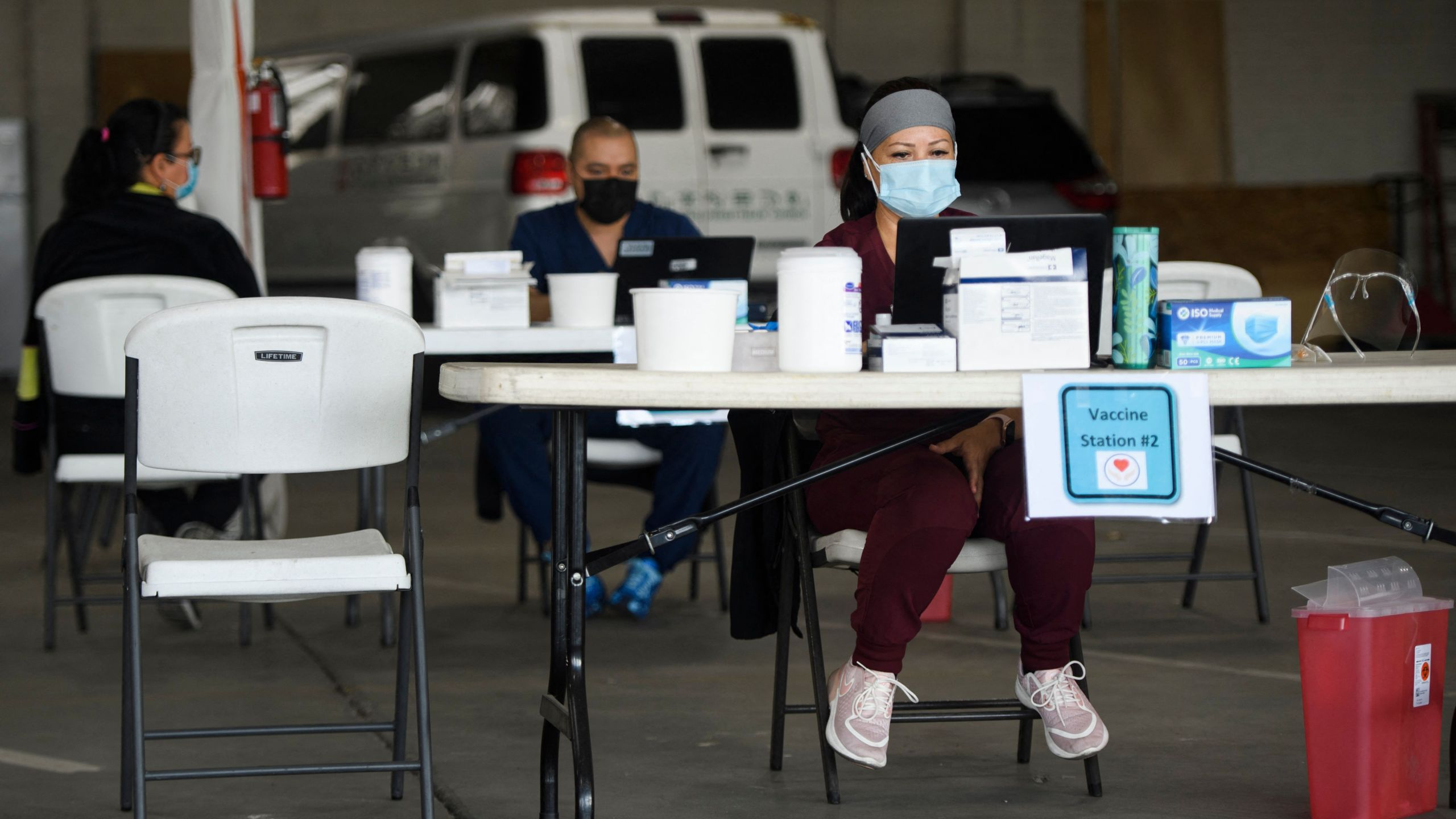 A nurse waits at an empty table for more patients to arrive to receive a dose of the Moderna Covid-19 vaccine at a Veterans Administration (VA) Long Beach Healthcare System pop-up vaccination site at the Dae Hueng Presbyterian Church on April 17, 2021 in Gardena, California. (PATRICK T. FALLON/AFP via Getty Images)