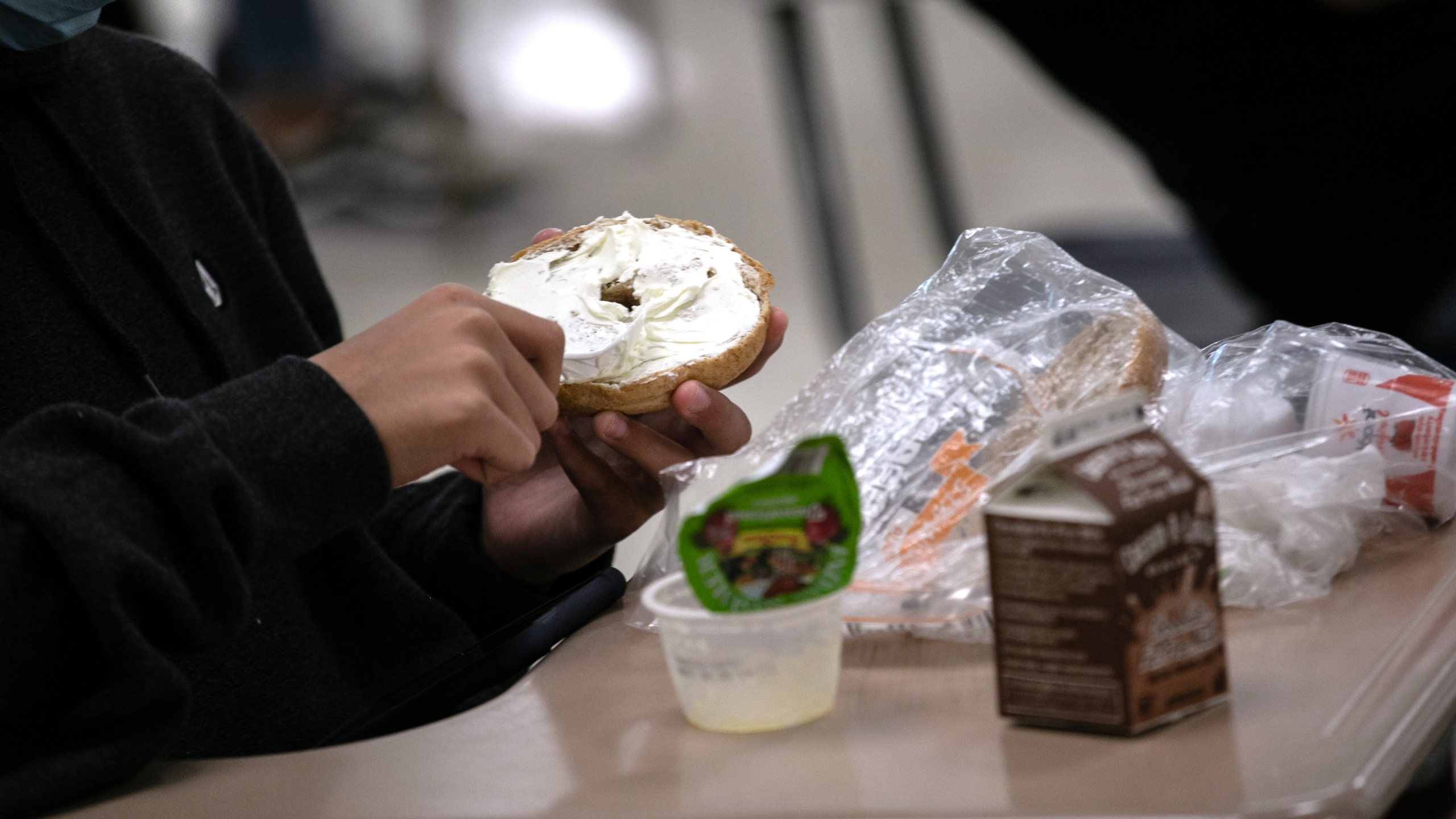 A student prepares lunch in the cafeteria during the first day of school at Stamford High School on Sept. 8, 2020, in Stamford, Connecticut. (John Moore/Getty Images)