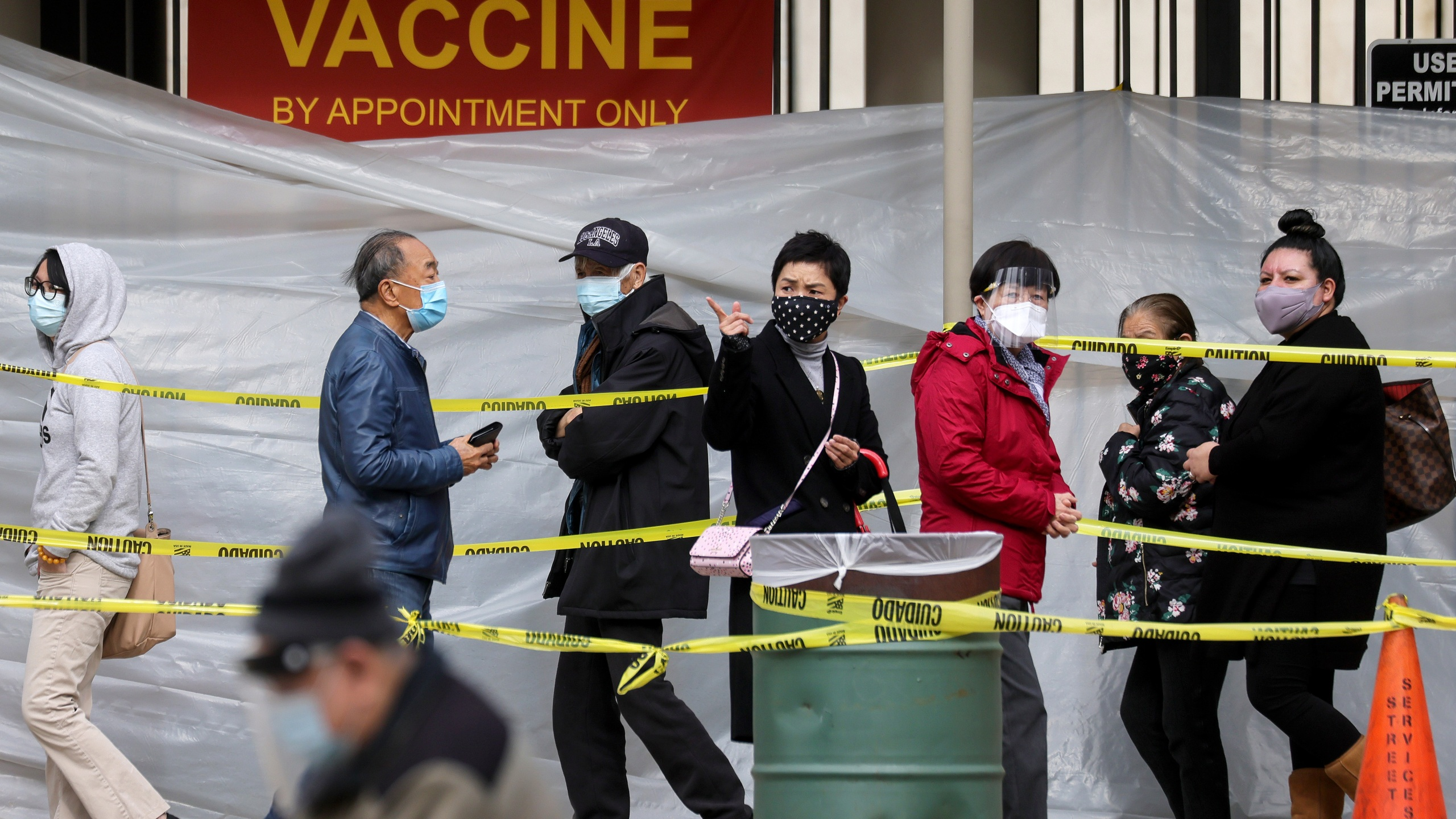 People with appointments walk in line to receive the COVID-19 vaccine at a vaccination site at Lincoln Park amid eased lockdown restrictions on January 28, 2021 in Los Angeles, California. (Mario Tama/Getty Images)