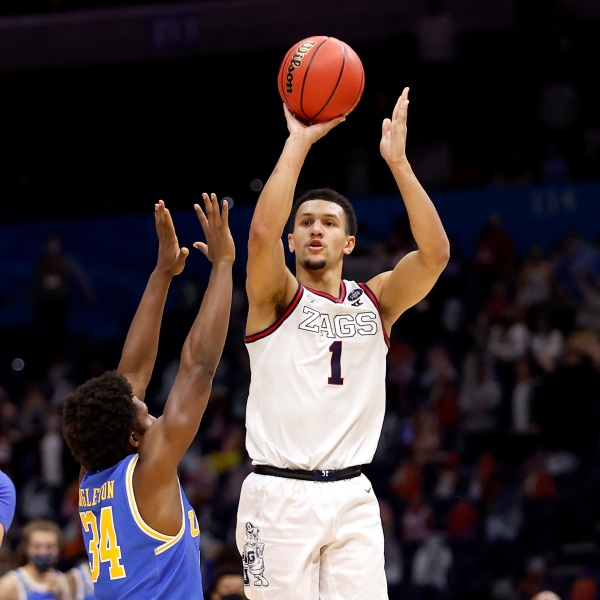 Jalen Suggs #1 of the Gonzaga Bulldogs shoots a game-winning three point basket in overtime to defeat the UCLA Bruins 93-90 during the 2021 NCAA Final Four semifinal at Lucas Oil Stadium on April 03, 2021 in Indianapolis, Indiana. (Photo by Jamie Squire/Getty Images)