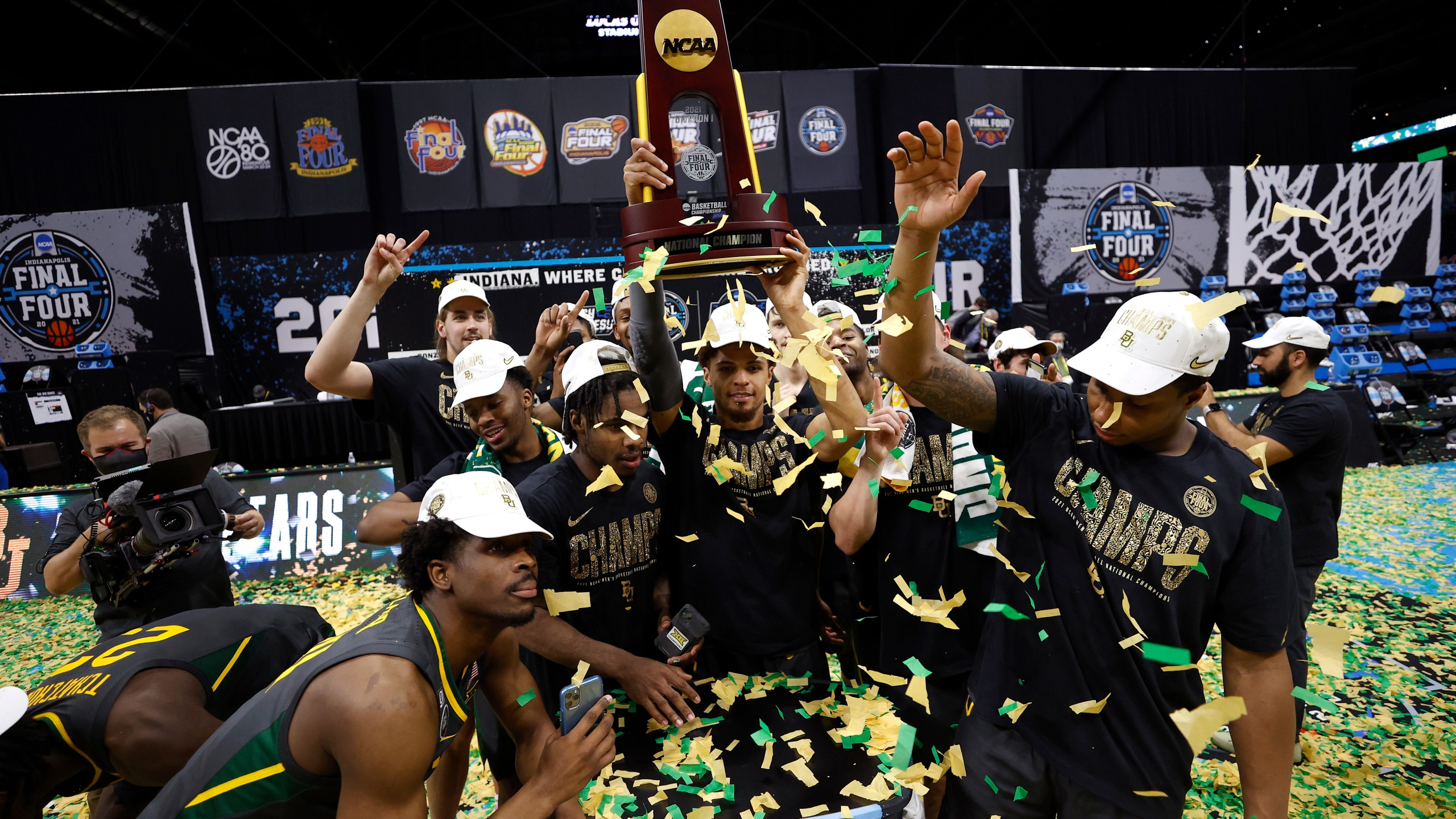 MaCio Teague #31 of the Baylor Bears holds up the trophy after defeating the Gonzaga Bulldogs 86-70 in the National Championship game of the 2021 NCAA Men's Basketball Tournament at Lucas Oil Stadium on April 5, 2021, in Indianapolis, Indiana. (Jamie Squire/Getty Images)