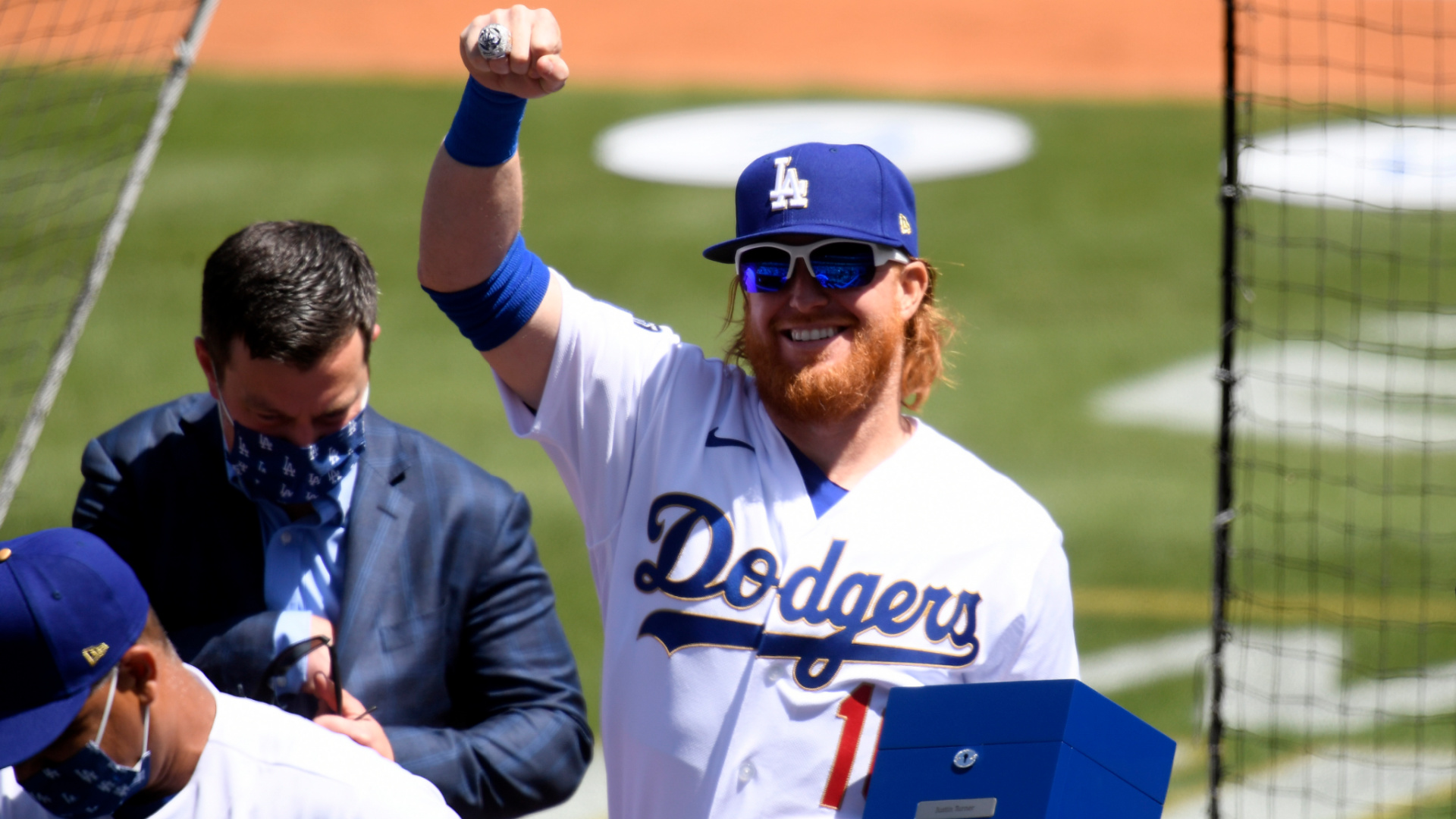 Justin Turner #2 of the Los Angeles Dodgers acknowledges the crowd after receiving his World Series ring prior to the game against the Washington Nationals at Dodger Stadium on April 9, 2021 in Los Angeles. (Harry How/Getty Images)