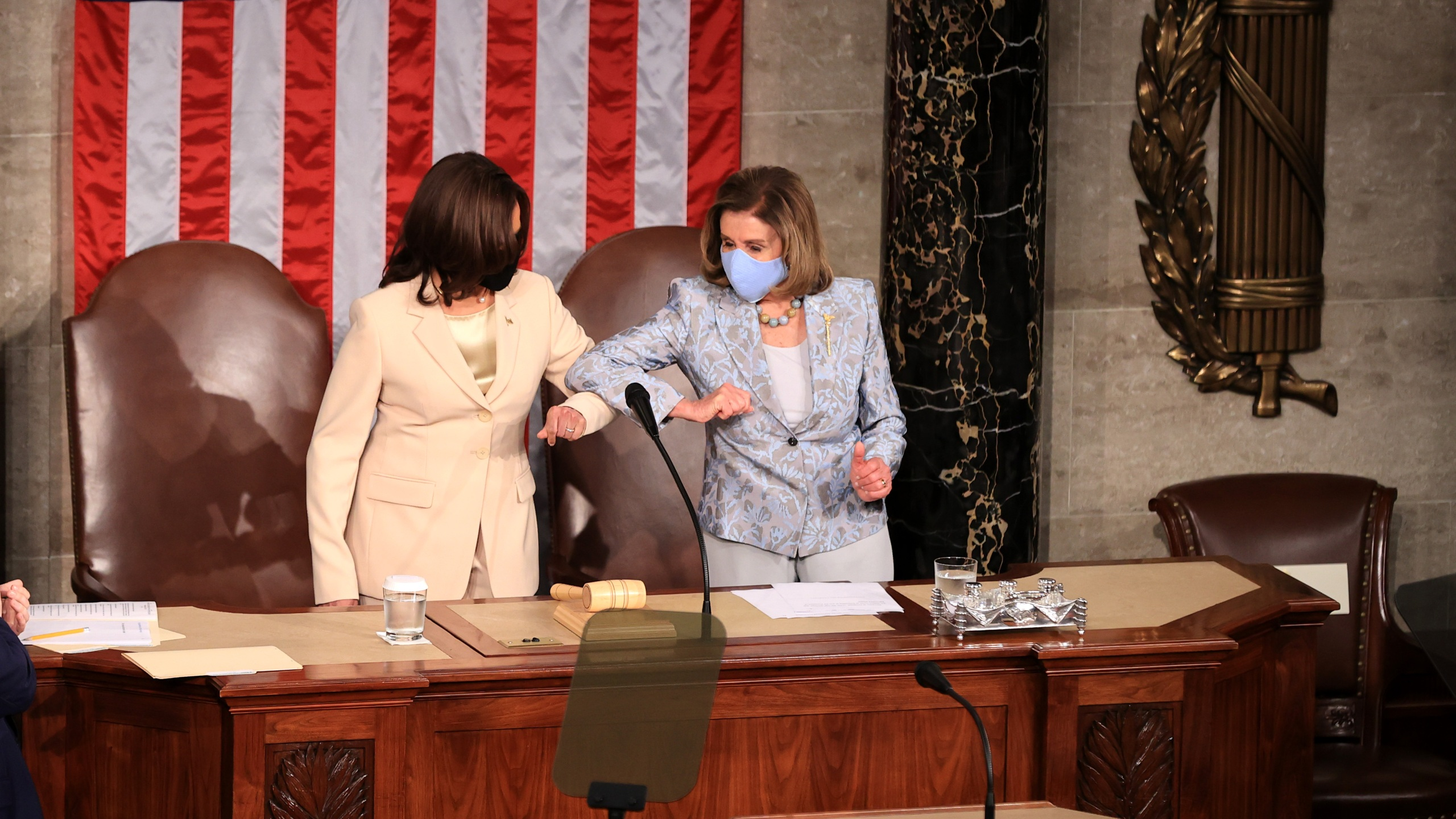 Vice President Kamala Harris and Speaker of the House Nancy Pelosi (D-CA) greet each other before U.S. President Joe Biden addresses a joint session of congress in the House chamber of the U.S. Capitol on April 28, 2021, in Washington, DC. (Chip Somodevilla/Getty Images)