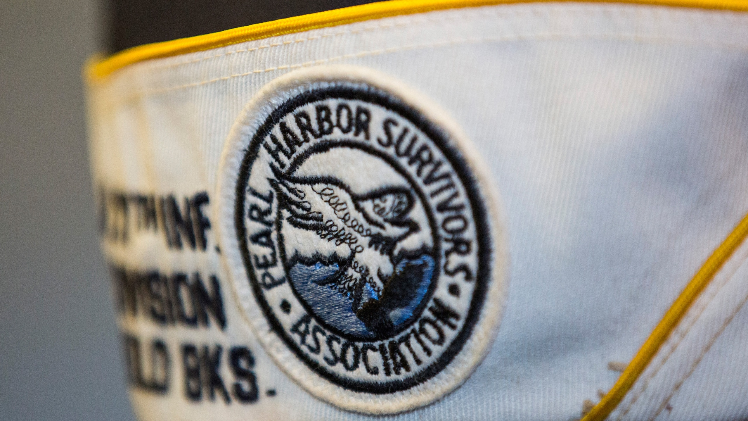 Detail of the hat of a survivor of the attack on Pearl Harbor as he attends a ceremony marking the anniversary of the attack on the Intrepid Sea, Air and Space Museum on December 7, 2015 in New York City. (Andrew Burton/Getty Images)