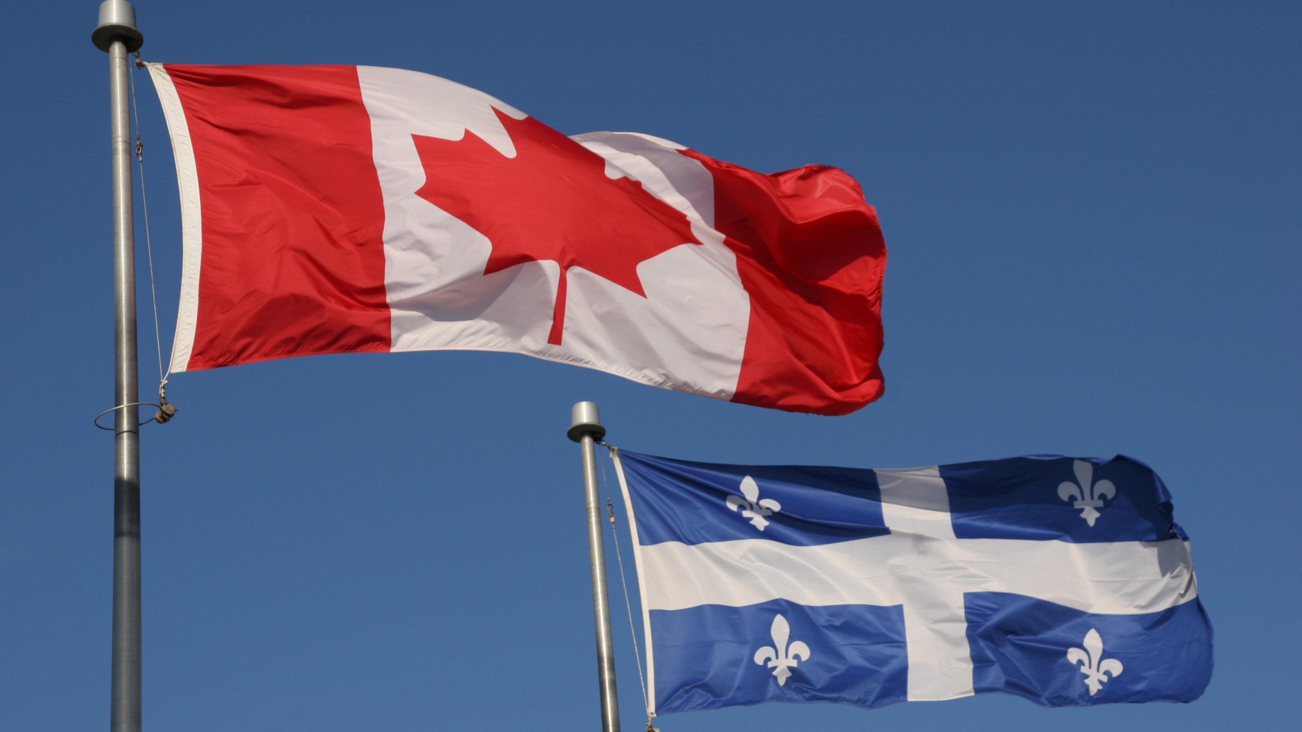 Canadian and Quebec flags are seen in a file photo. (iStock/Getty Images Plus)
