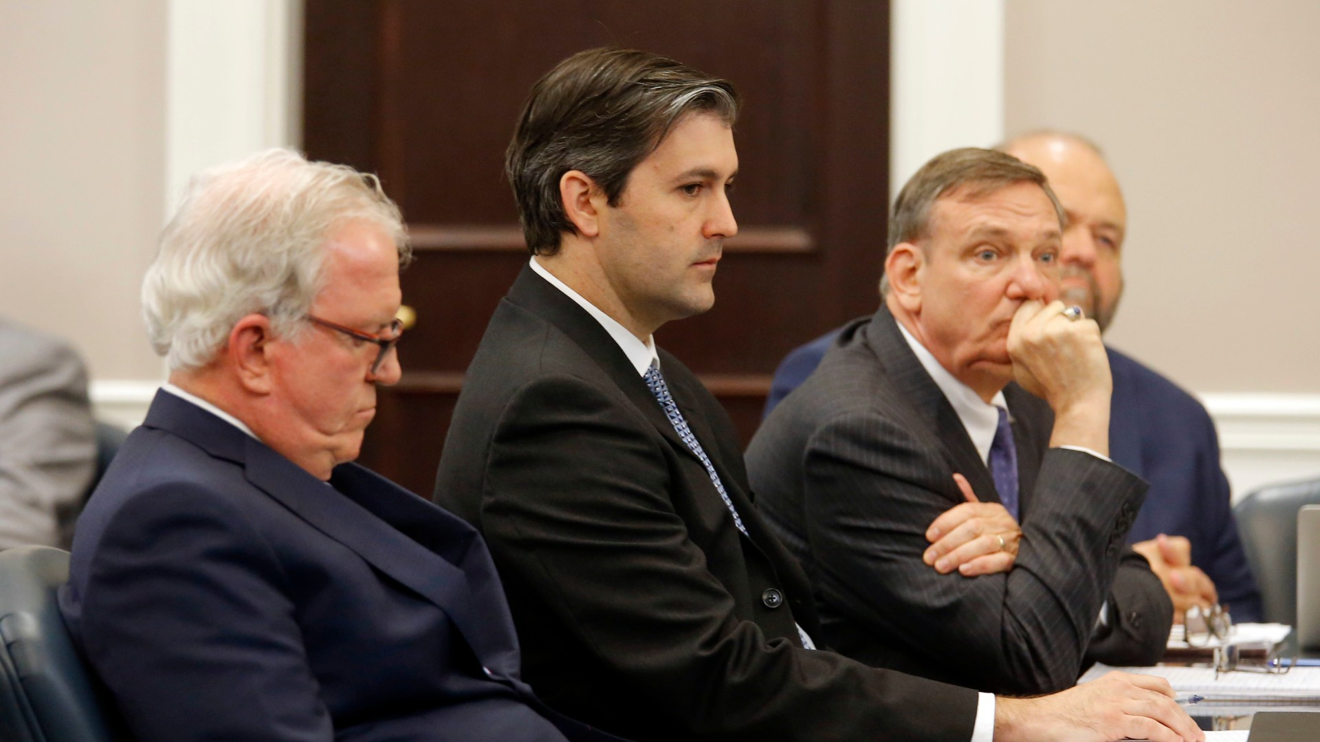 In this Dec. 5, 2016 file photo, defense attorneys Andy Savage, left, Don McCune, and Miller Shealy, right, sit around former North Charleston police officer Michael Slager at theCharleston County court in Charleston, S.C. Slager, who is serving 20 years in prison for killing an unarmed Black man who was running away from a traffic stop, said his lawyer never told him about a plea offer from prosecutors that could have cut years off his sentence and is asking for a new sentence in federal court this week. (Grace Beahm/Post and Courier via AP, Pool)