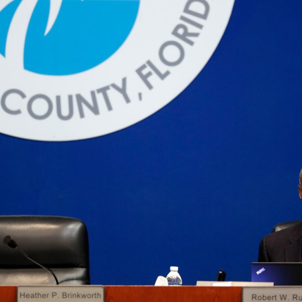 In this March 5, 2019 photo, Broward County Schools Superintendent Robert Runcie waits for the start of a meeting of the Broward County School Board in Fort Lauderdale, Fla. The superintendent of the Florida school district where 17 students and staff died in a 2018 high school massacre has been arrested on a perjury charge. Jail records show Broward County Schools Superintendent Runcie was arrested Wednesday, April 21, 2021 by the Florida Department of Law Enforcement. (AP Photo/Lynne Sladky)