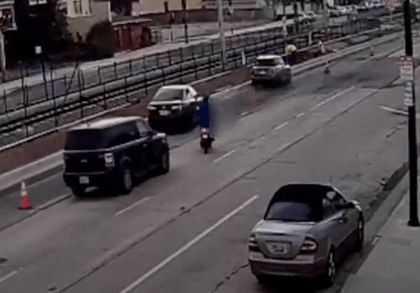 A photo taken from surveillance video released by LAPD shows the moment before a hit-and-run driver struck a moped in Leimert Park on April 1, 2021.