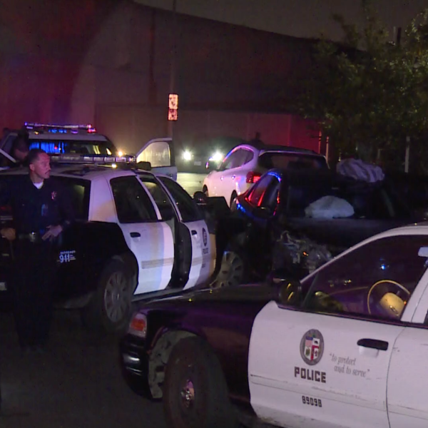 Police respond to the scene of a crash following a pursuit in the area of 64th Street and Budlong Avenue in South L.A. April 10, 2021. (RMG News)