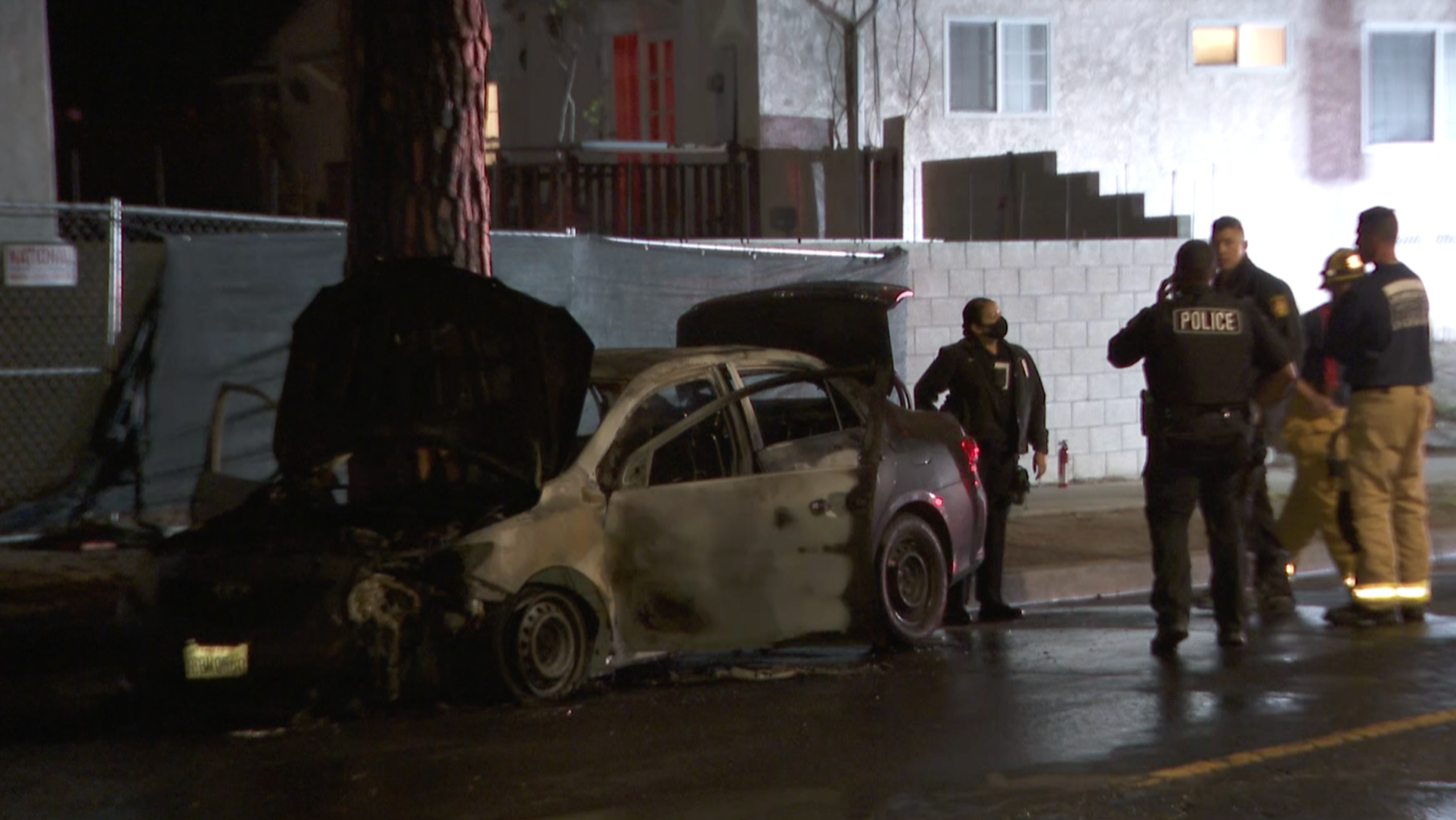 Authorities respond to investigate after a man and stolen vehicle were found engulfed in flames in Rancho Park on April 12, 2021. (KTLA)