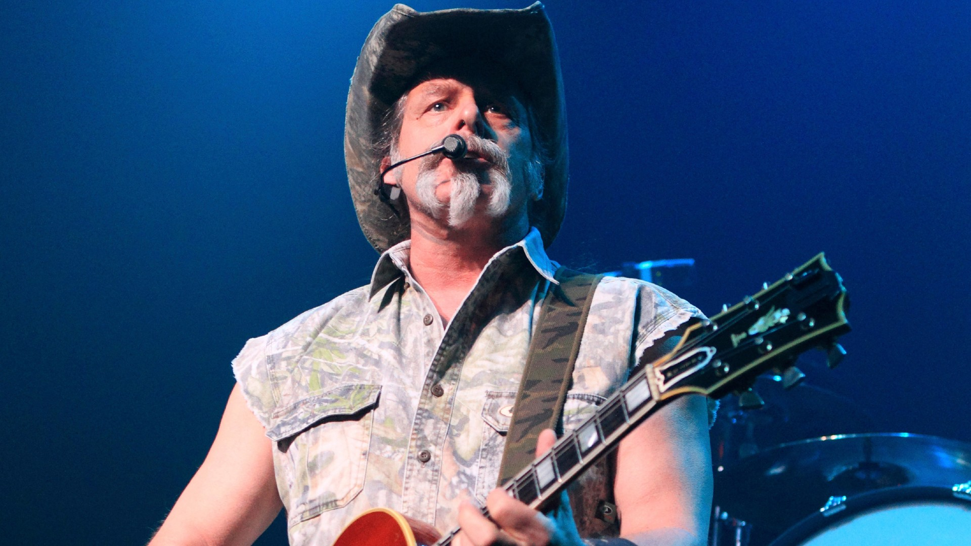 "Ted Nugent performs at Rams Head Live in Baltimore on Aug. 16, 2013. Nugent revealed he was in agony after testing positive for coronavirus — months after he said the virus was ""not a real pandemic."" ""I thought I was dying,"" Nugent says in a Facebook live video posted Monday. (Photo by Owen Sweeney/Invision/AP, File)"