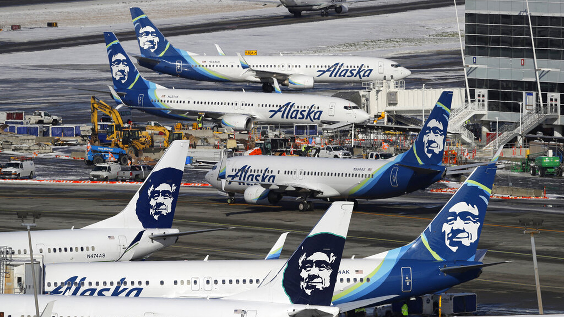 In this Feb. 5, 2019, file photo, Alaska Airlines planes are parked at a gate area at Seattle-Tacoma International Airport in Seattle. AP Photo/Ted S. Warren, File)