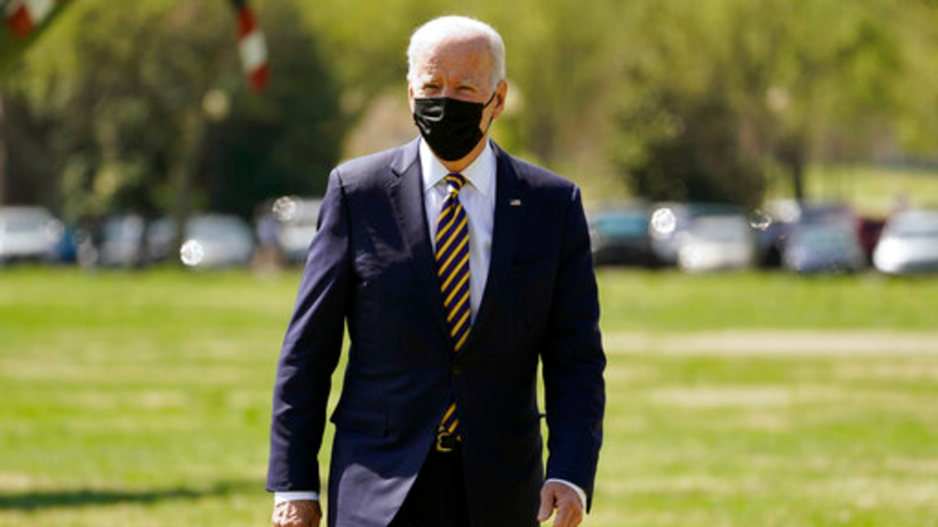 President Joe Biden walks over to speak to members of the media after arriving on the Ellipse on the National Mall after spending the weekend at Camp David, Monday, April 5, 2021, in Washington. (AP Photo/Evan Vucci)